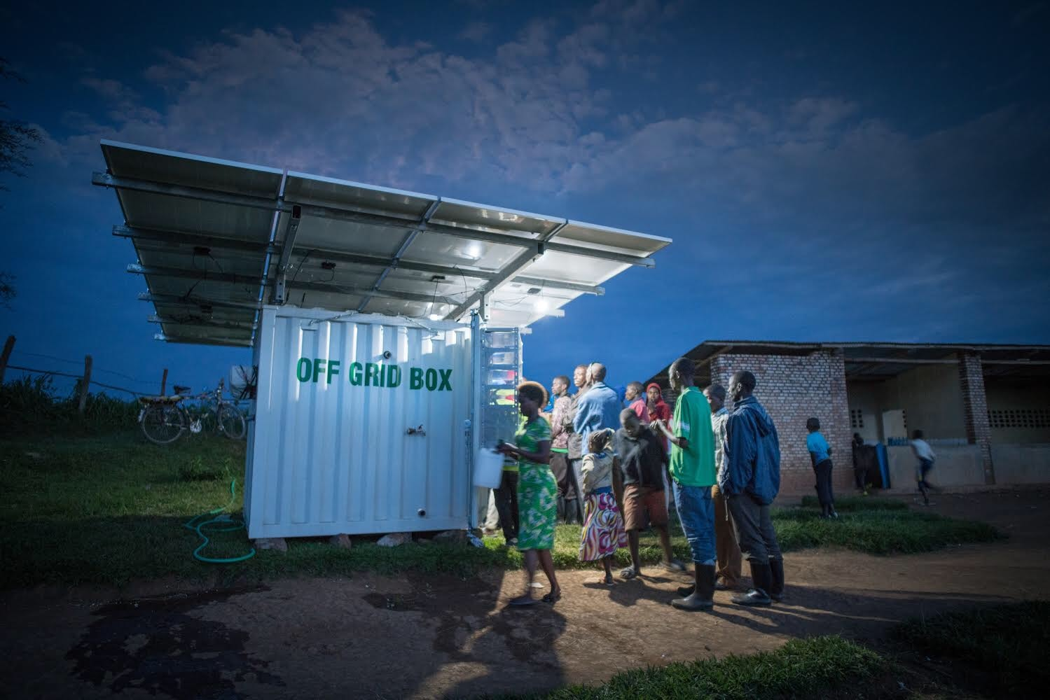 Village kiosk box in Rwanda providing rural electrification and purified water to a village.