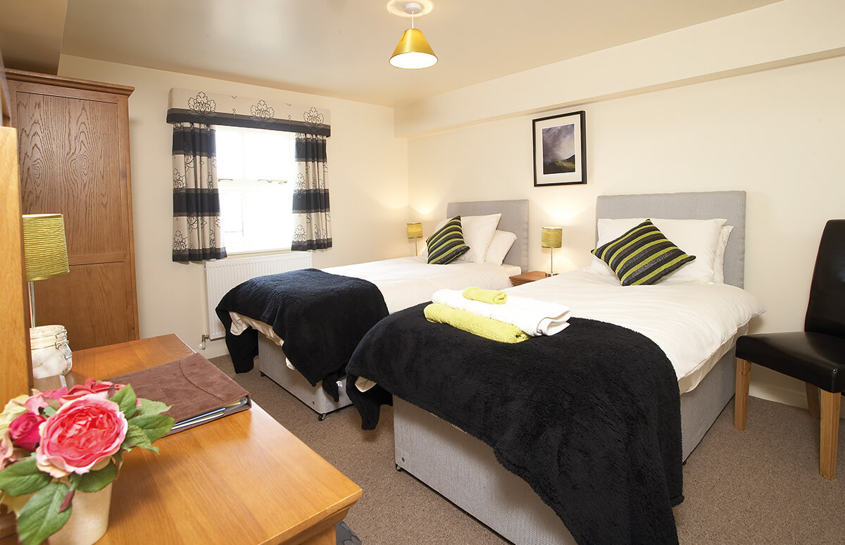 Hutton - Our Hutton Room is both charming and beautiful. The room is on the first floor with the choice of a double or twin beds. The Hutton Room comes with a modern en-suite shower room.BOOK NOW >