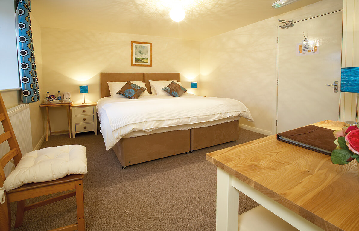 Kirkburn - Our ground floor Kirkburn Room is cosy and warm with a natural decor. Choose either a double or twin beds for your night's stay. Kirkburn has an en-suite shower room.BOOK NOW >