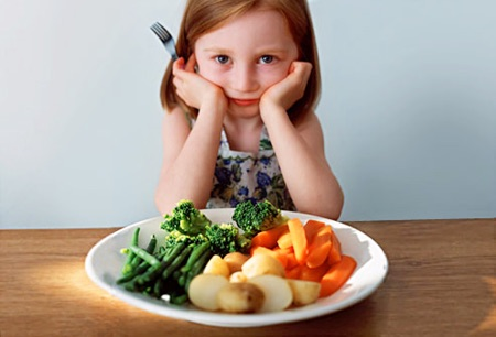 child with vegetables.jpg