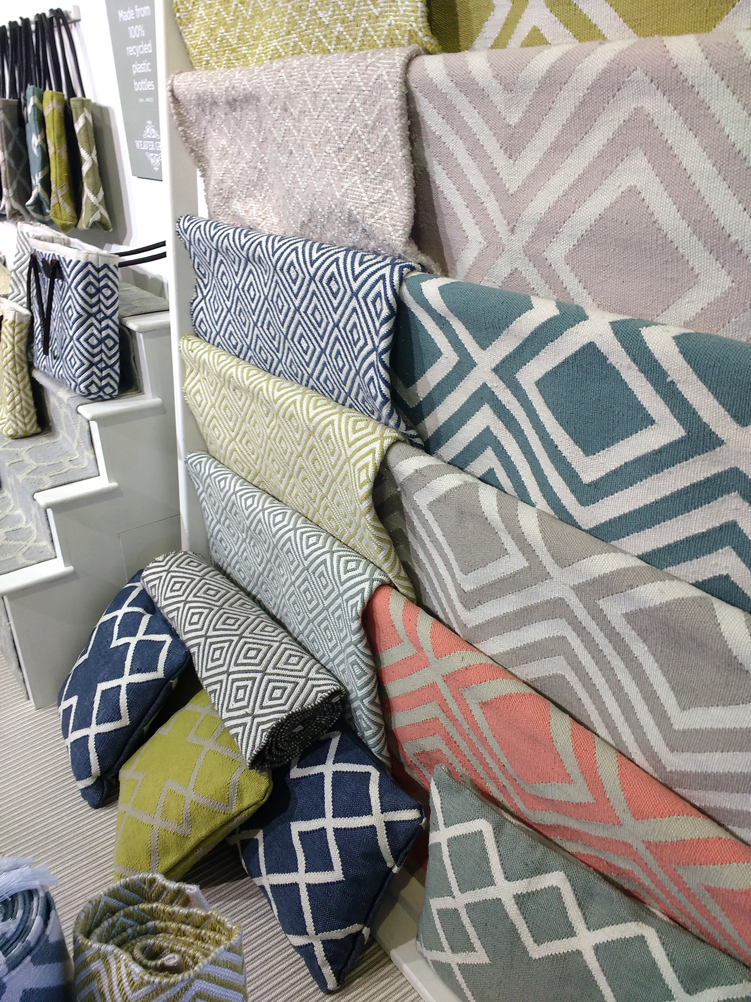 Close up of Weaver Green  Cushions  and  Rugs  at Top Drawer