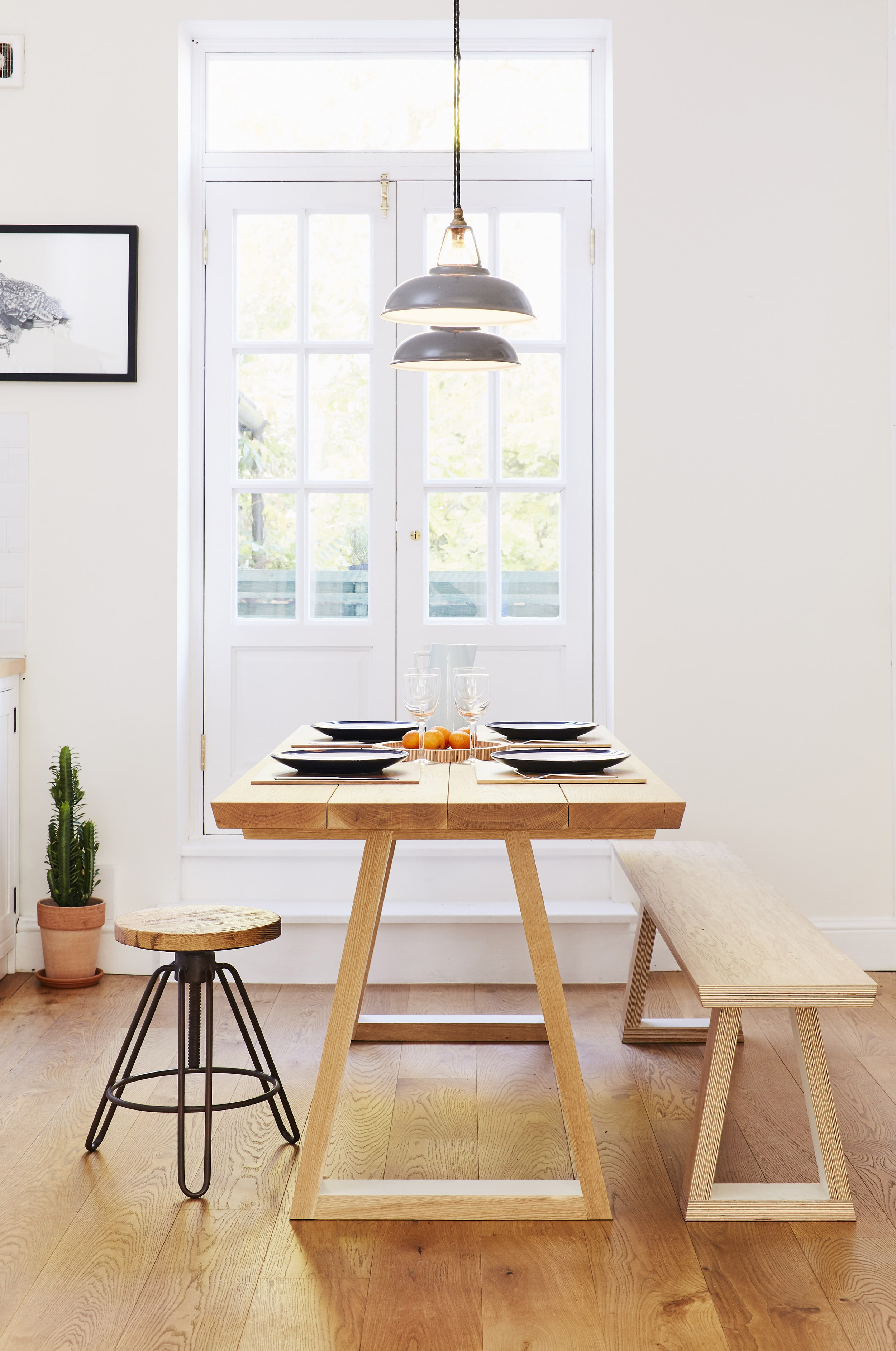 The one of a kind solid oak table and bench made for the kitchen.