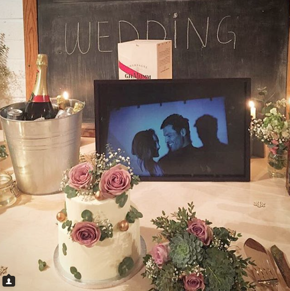 The beautiful cake from Lily Vanilli with the first picture ever taken of the couple by Magnus Arrevad.