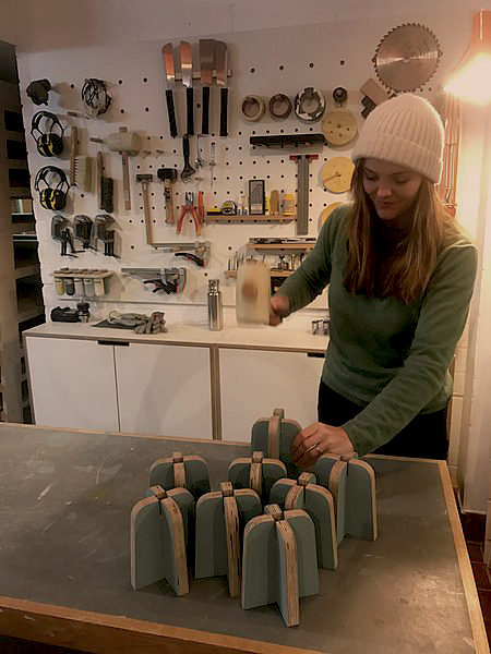 Barbara designed and made the candle holders for the table from plywood offcuts.