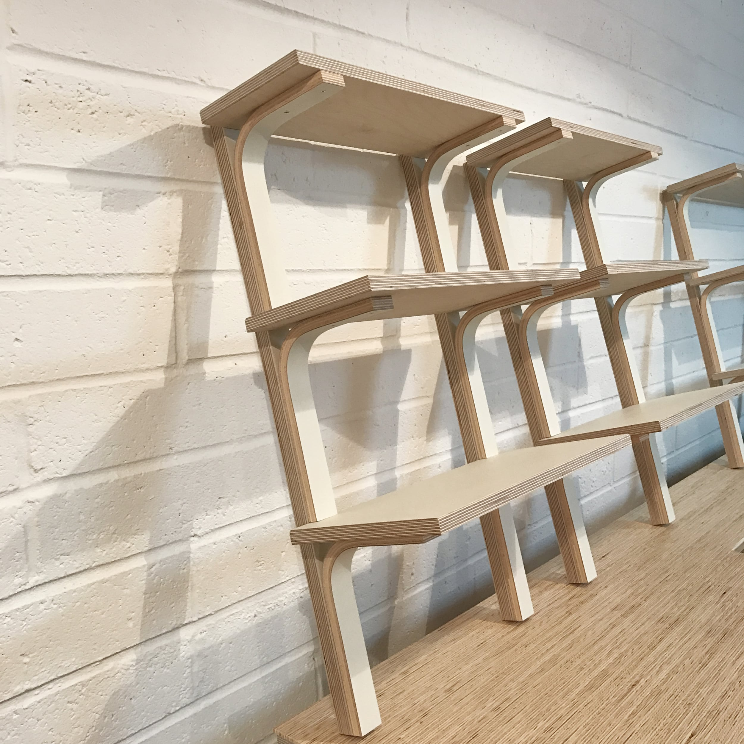 Georgina's bespoke shelving system before it was mounted to the wall. The same design was installed in her bedroom.