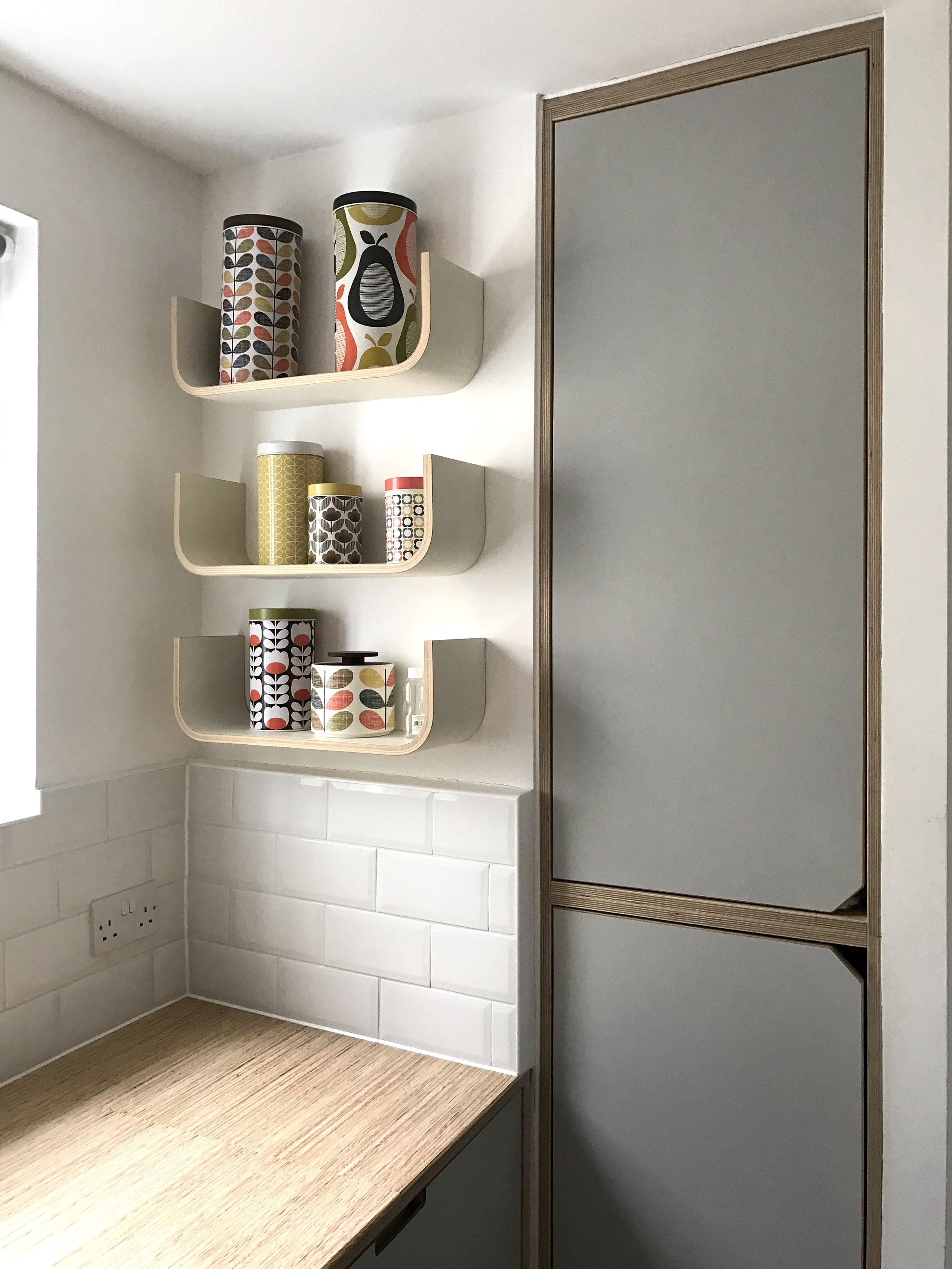 Bespoke painted U shelves create more storage space.