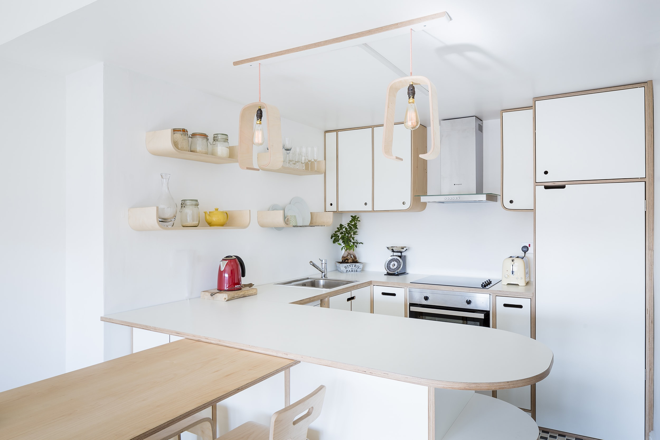 Fabienne's white laminate and birch plywood kitchen in Hackney East London.  By Lozi