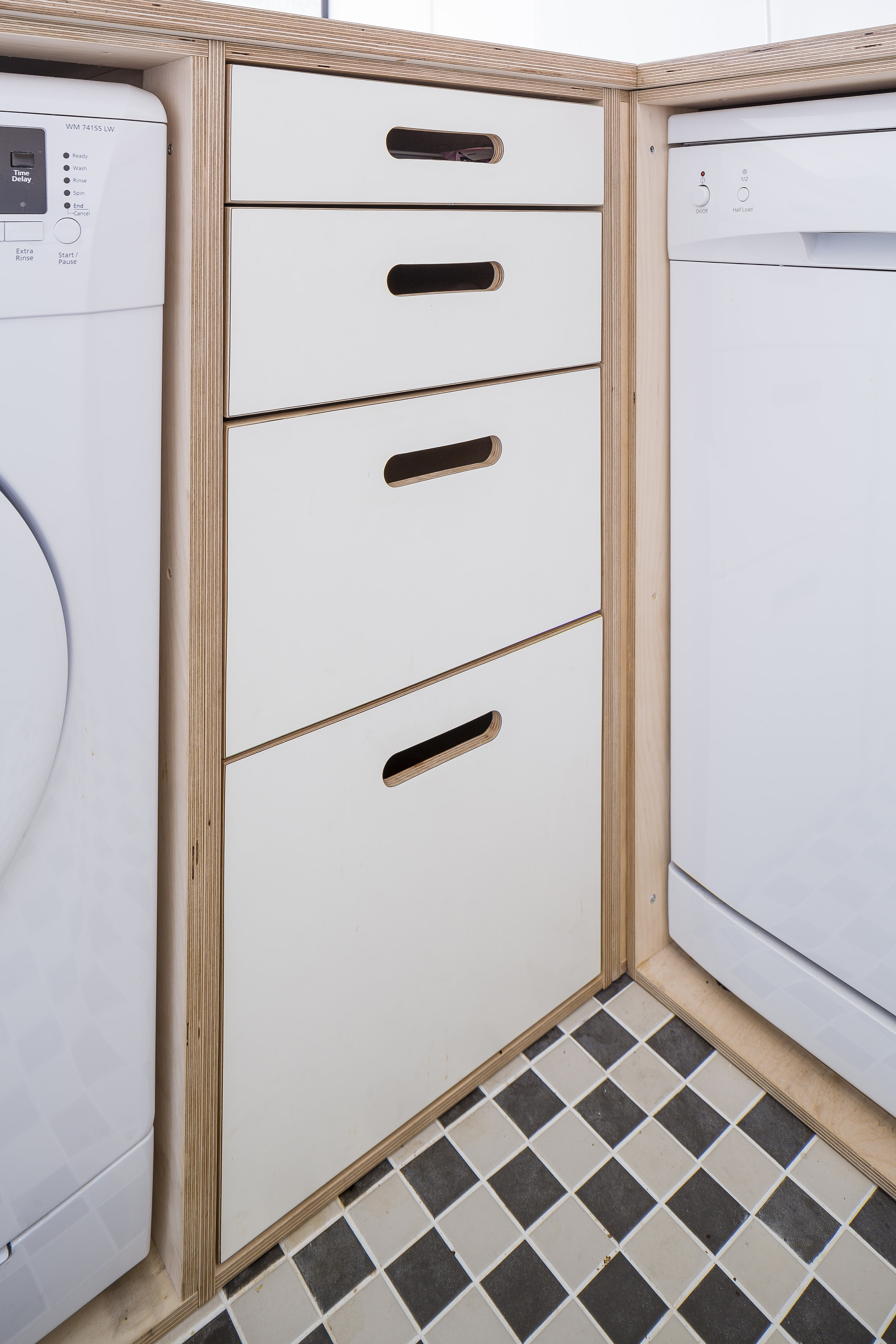 Cupboard space is fitted into every nook and cranny, making the most of a small room.