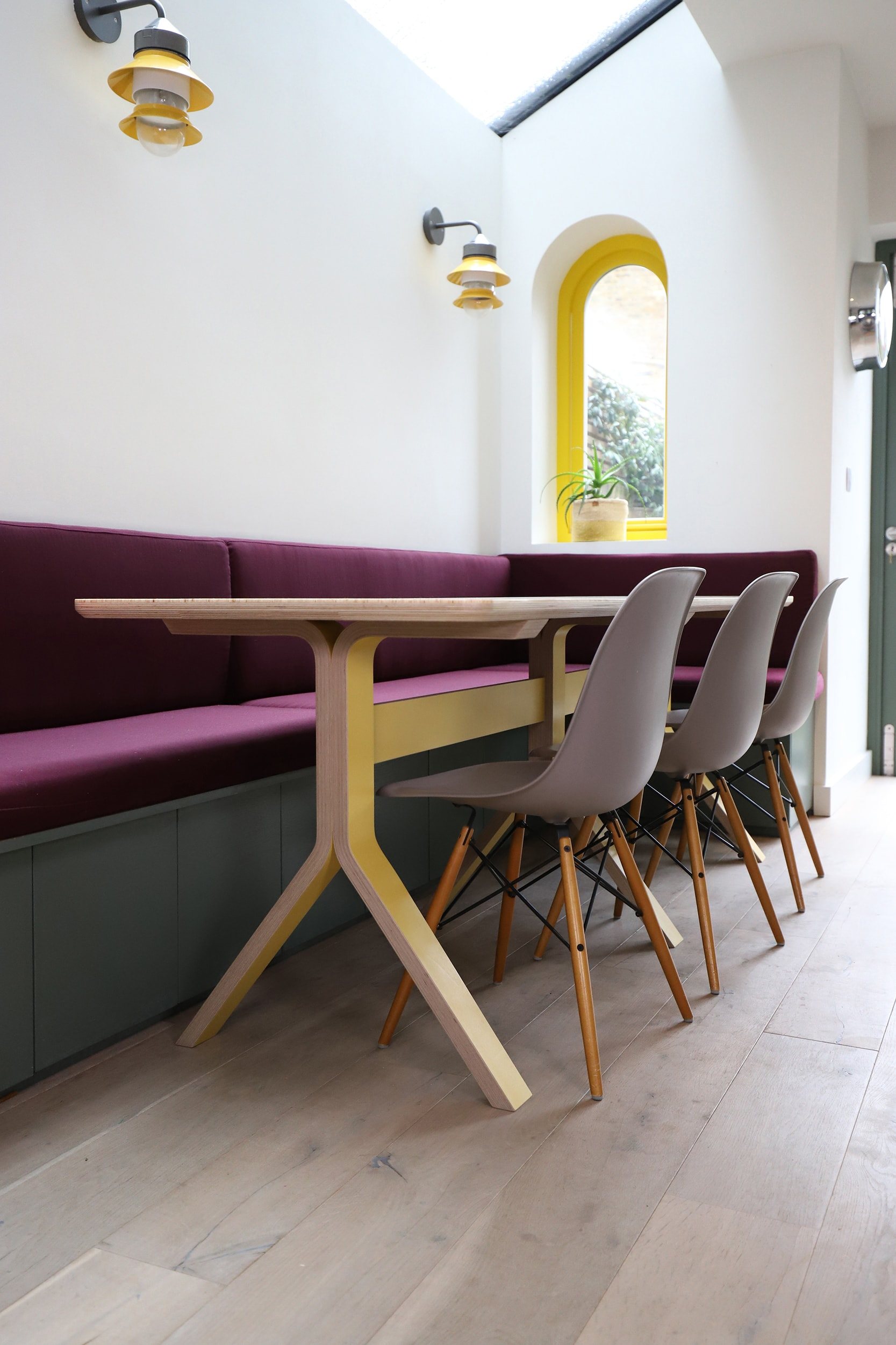 The Sea table in yellow with a sea of chairs and the bespoke seating area Lozi created.