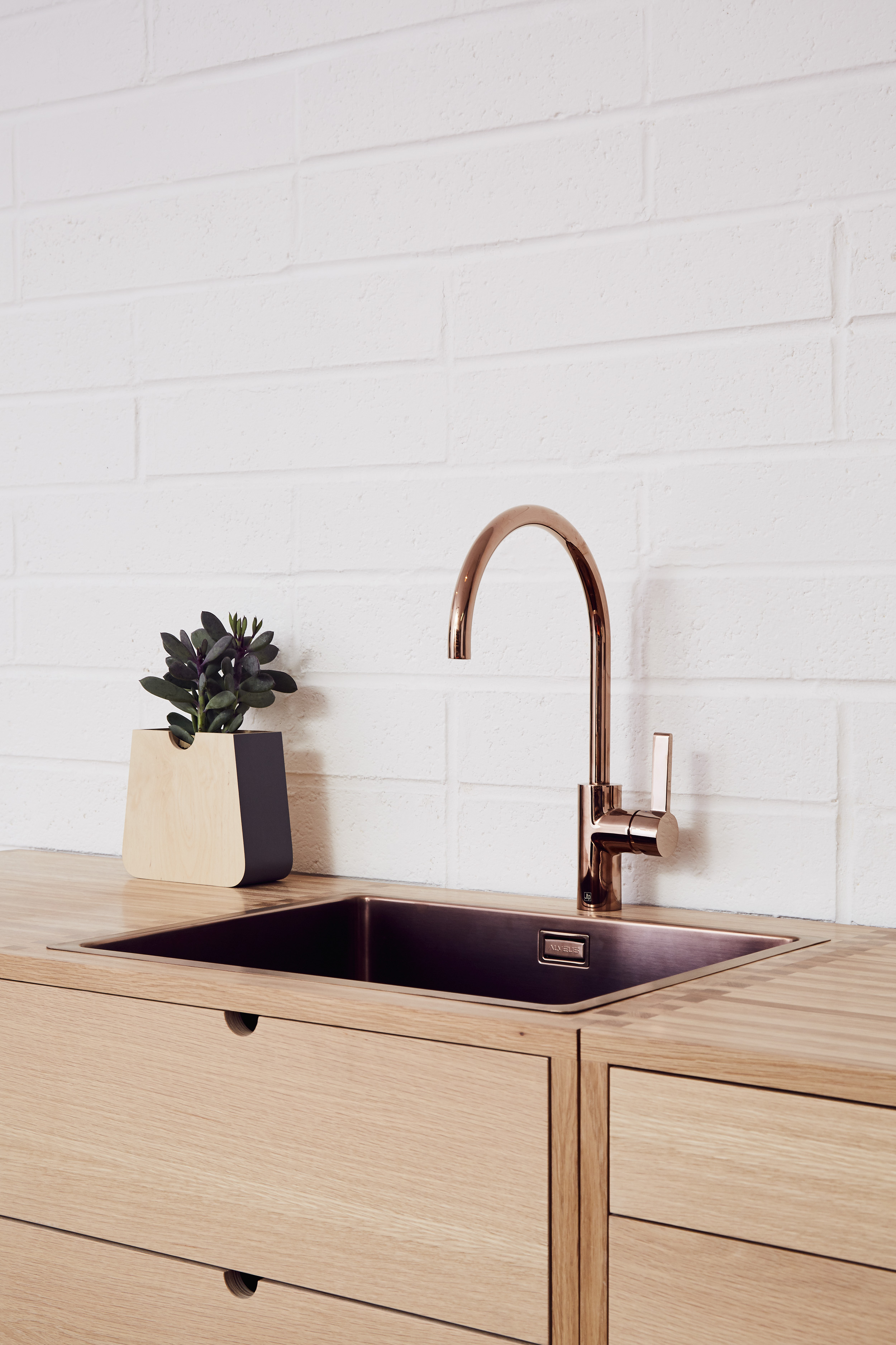 A close up of the unusual copper sink and tap