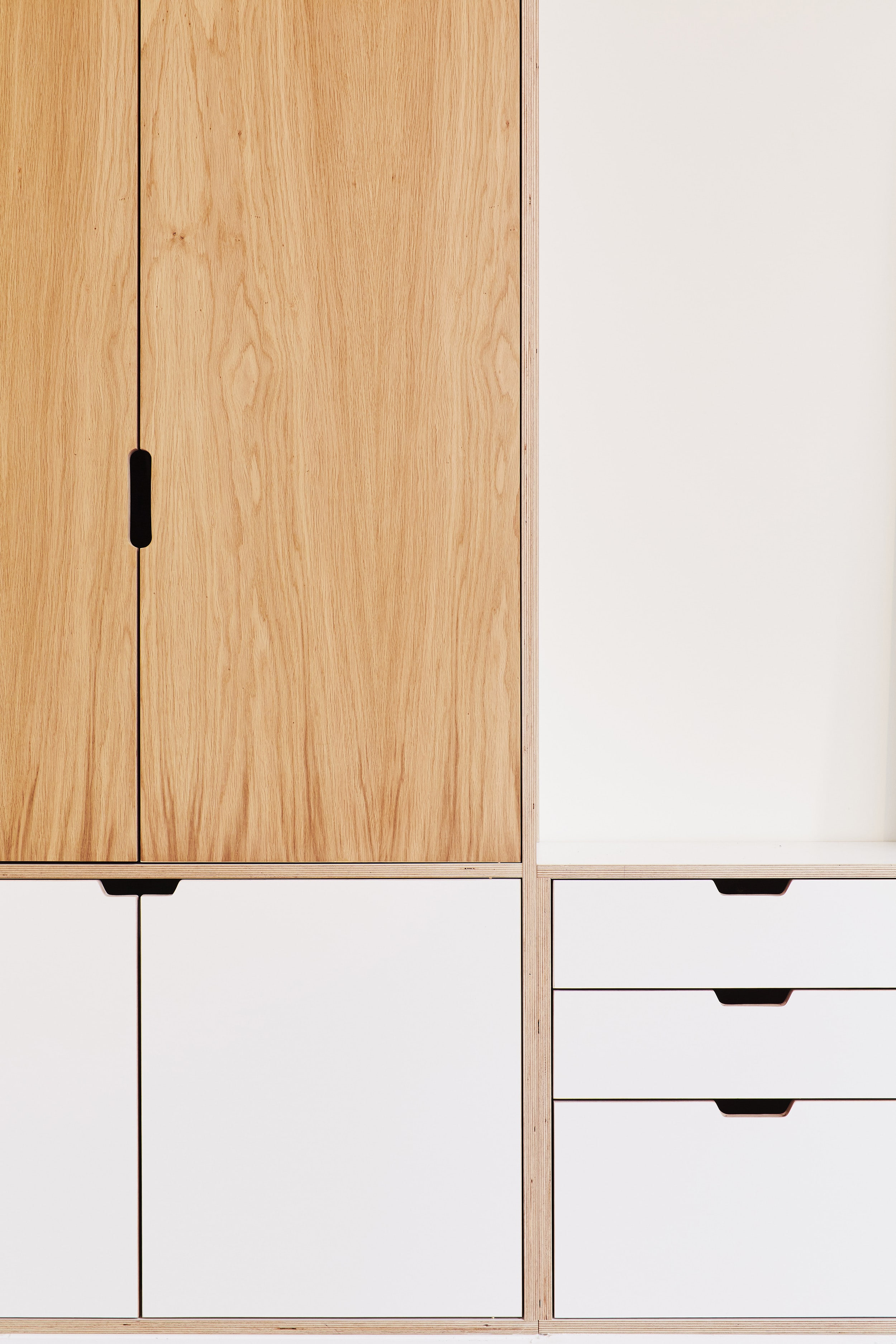 A detail of the oak veneer doors from the plywood wardrobe in Cass's house in Dalston, E8 designed by Lozi