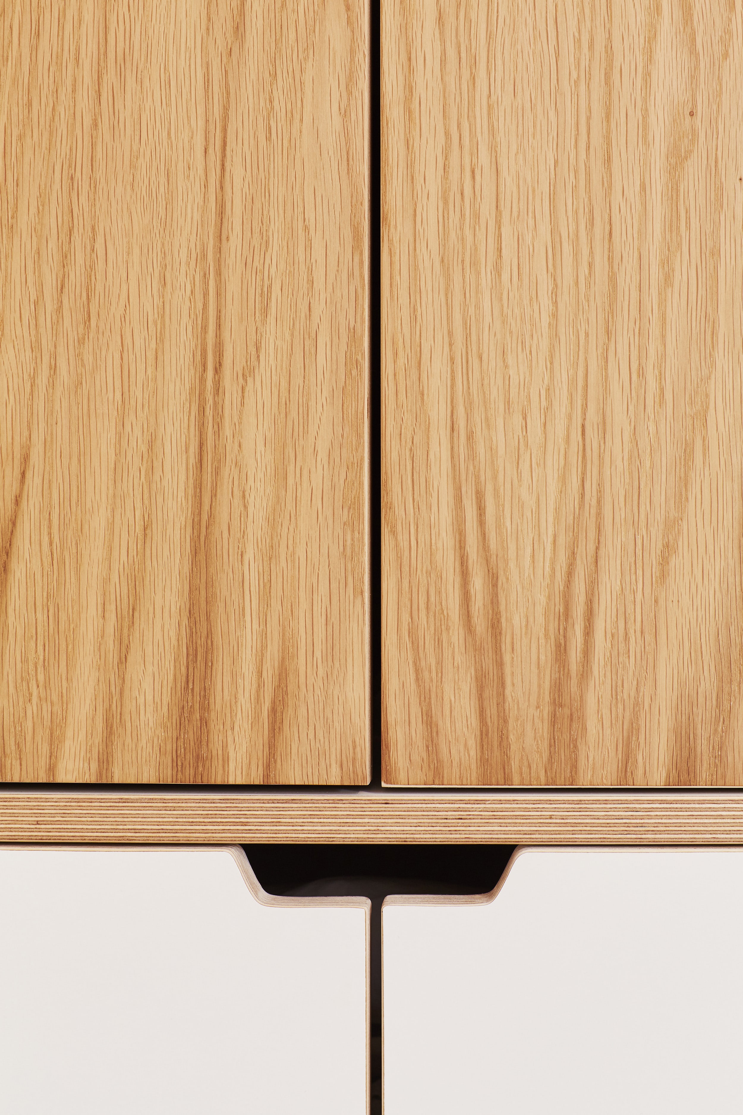 A close up of the handles from the plywood wardrobes designed by Lozi in Cass's home in Dalston, London E8.