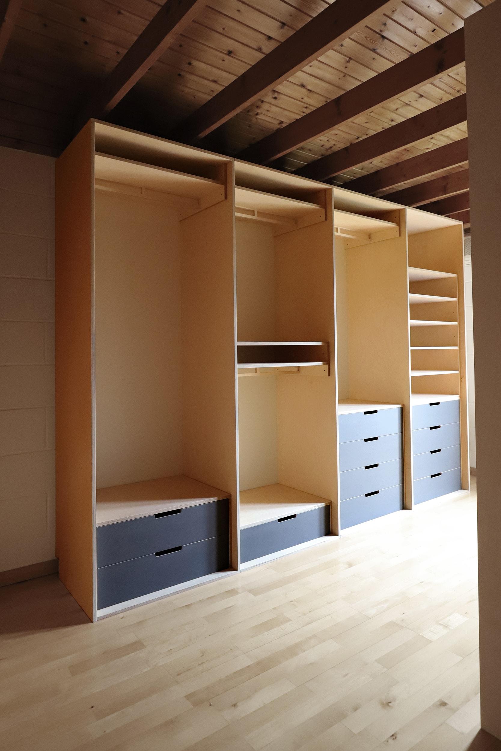 Samir's modern bespoke plywood walk in wardrobe by Lozi in his home in Bexley