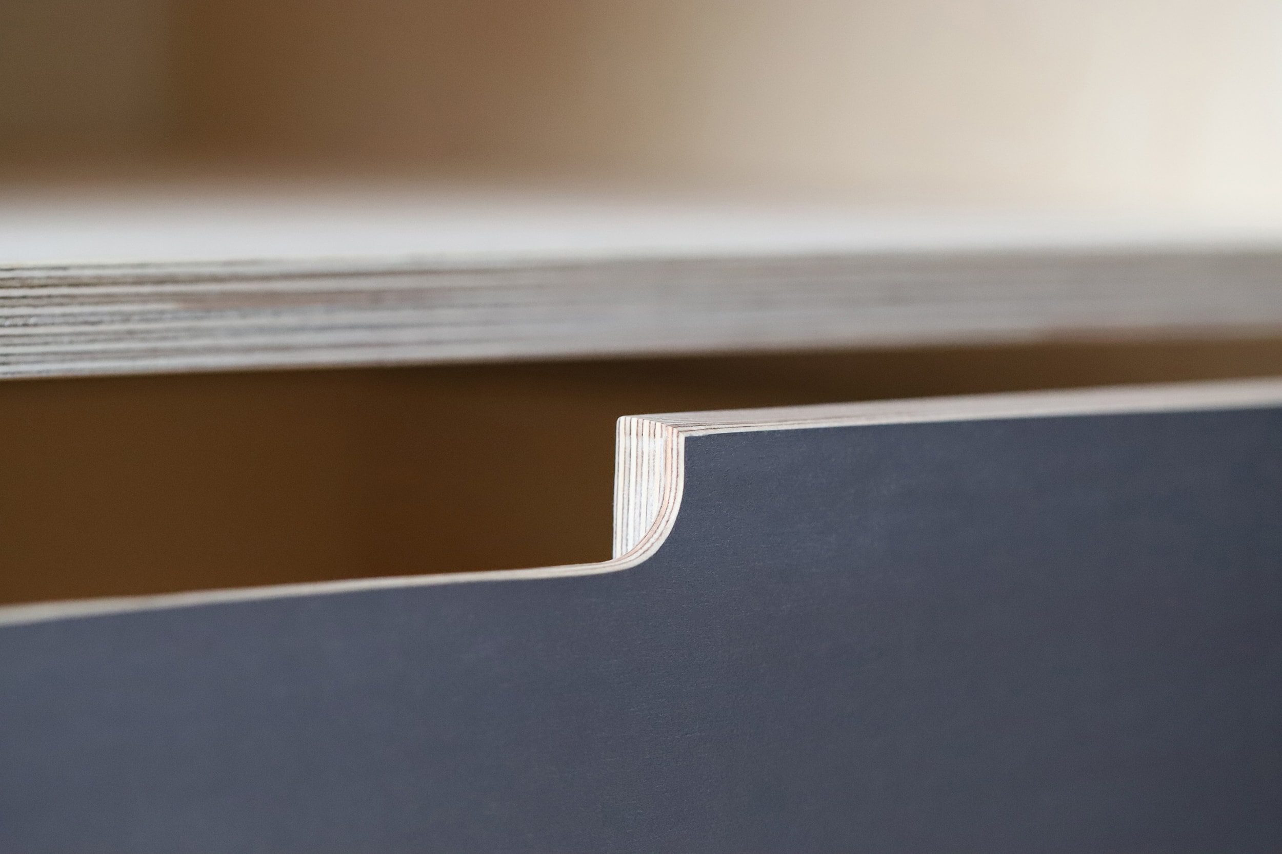 A handle details from Samir's bespoke plywood by Lozi in his home in Bexley