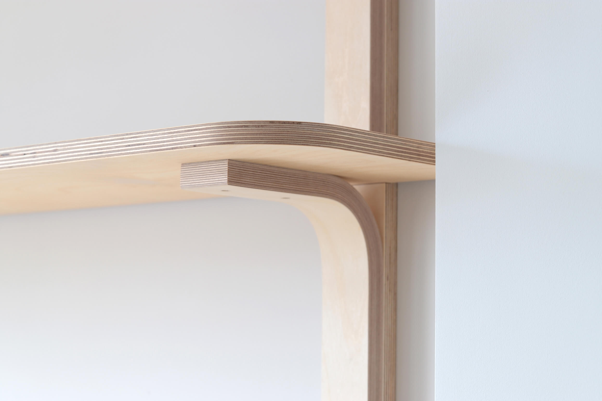 A close up of plywood shelving joint for living alcove storage by Lozi