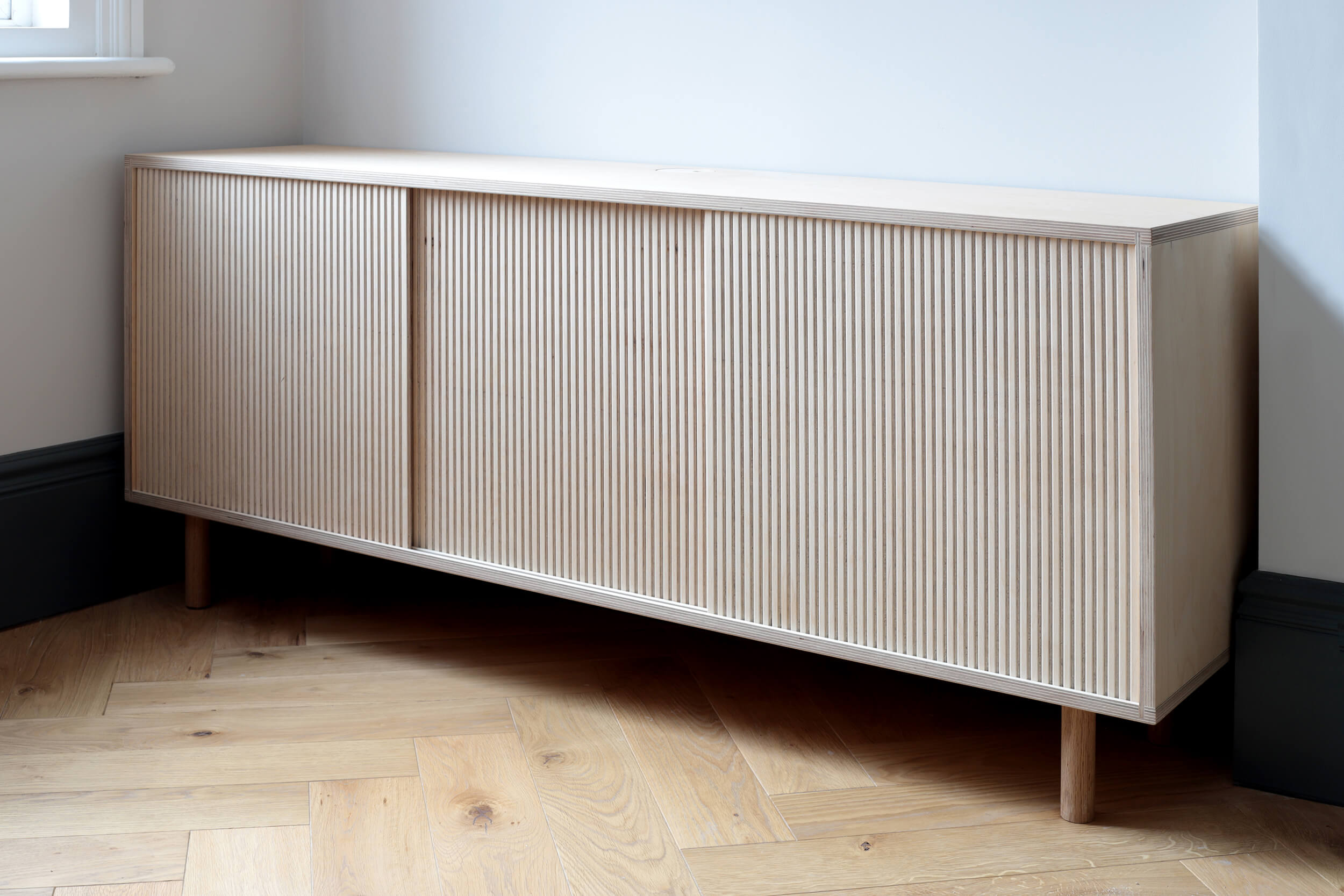George and Grace's living room plywood sideboard storage by Lozi