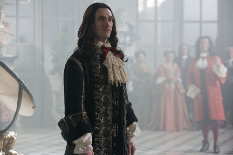 King Louis XIV (George Blagden) and his fabulously frilly shirt at home in Versailles.