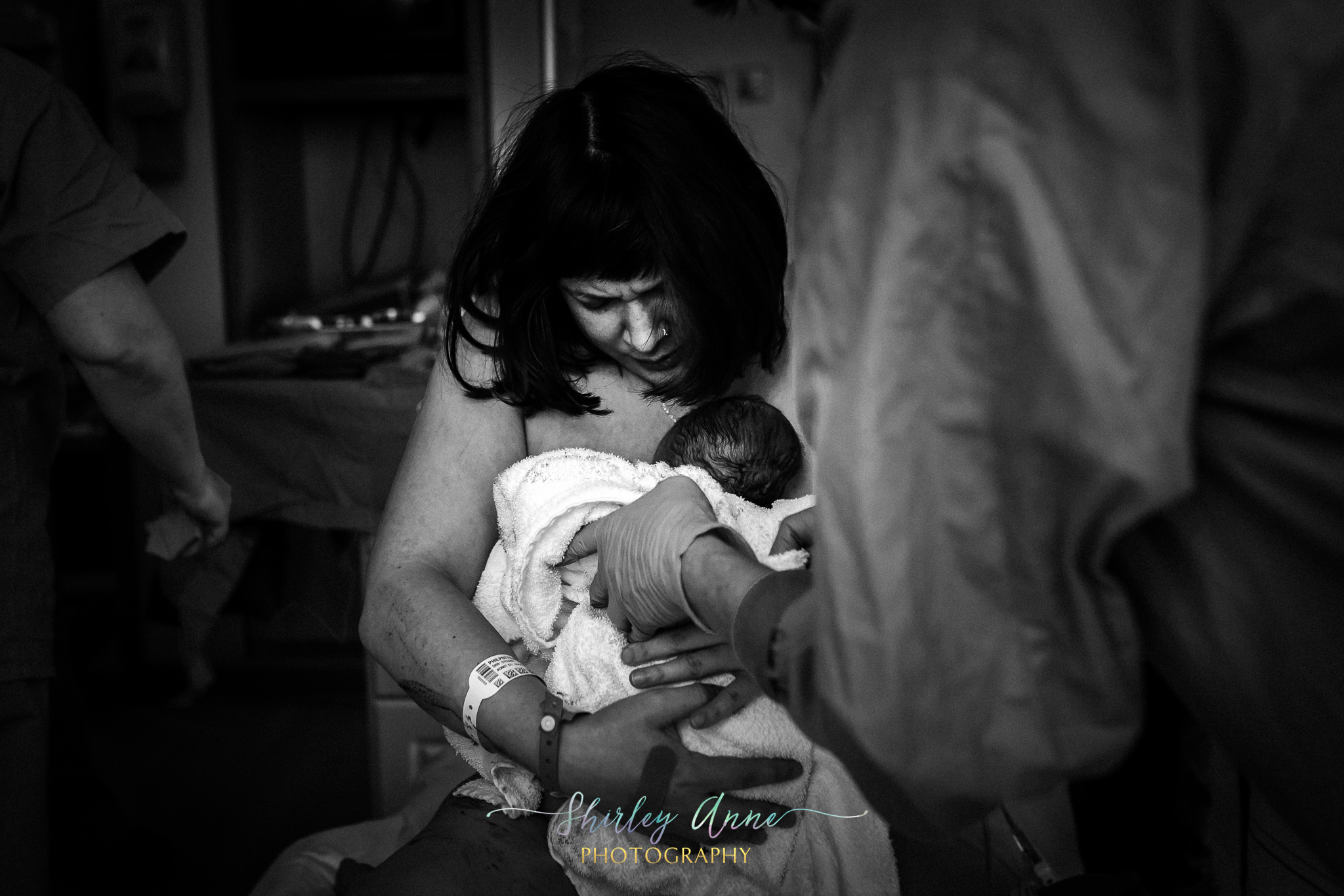 holding baby for the first time after labor and birth