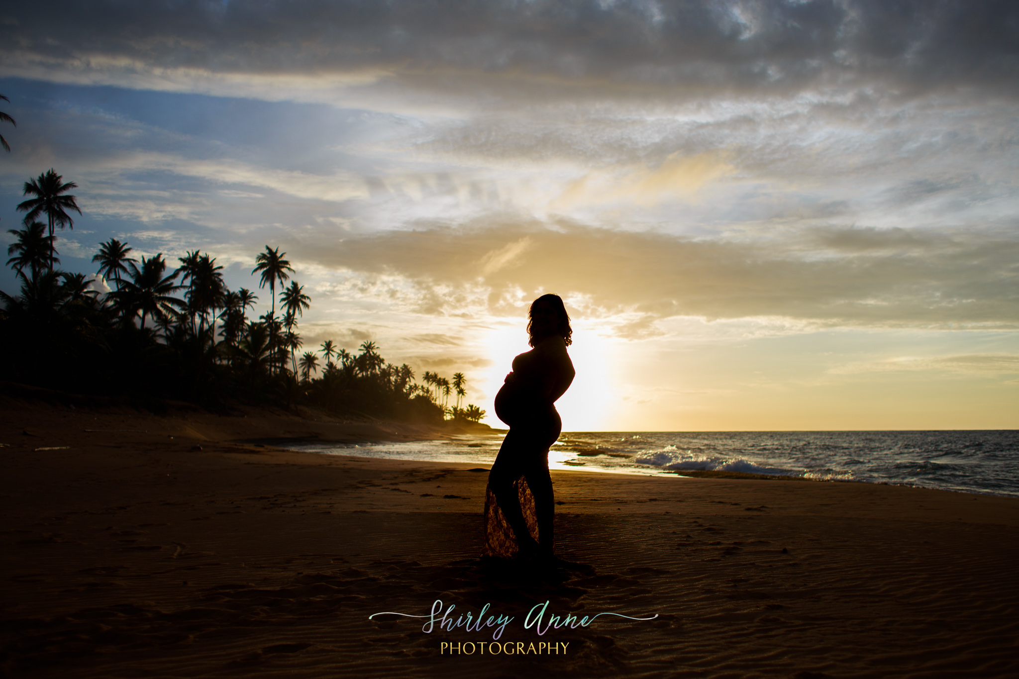 sunset with silhoutte of pregnant mom during maternity session