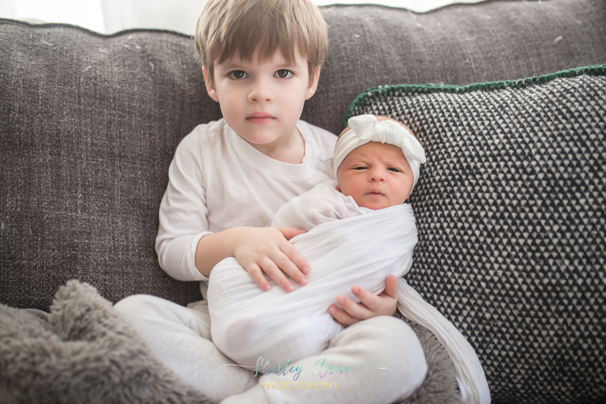 toddler boy with newborn sibling photo session