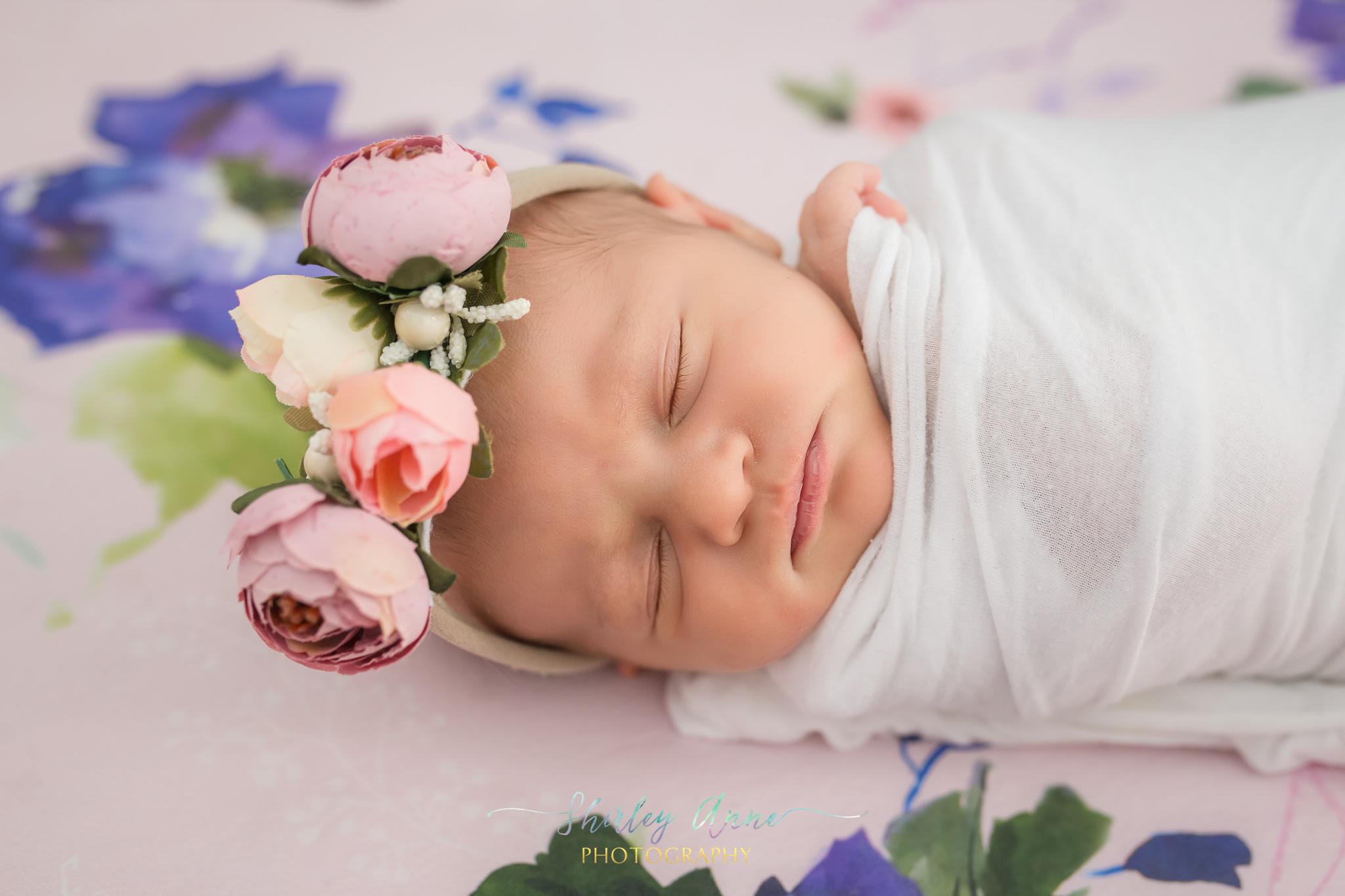 newborn baby with flower crown newborn session