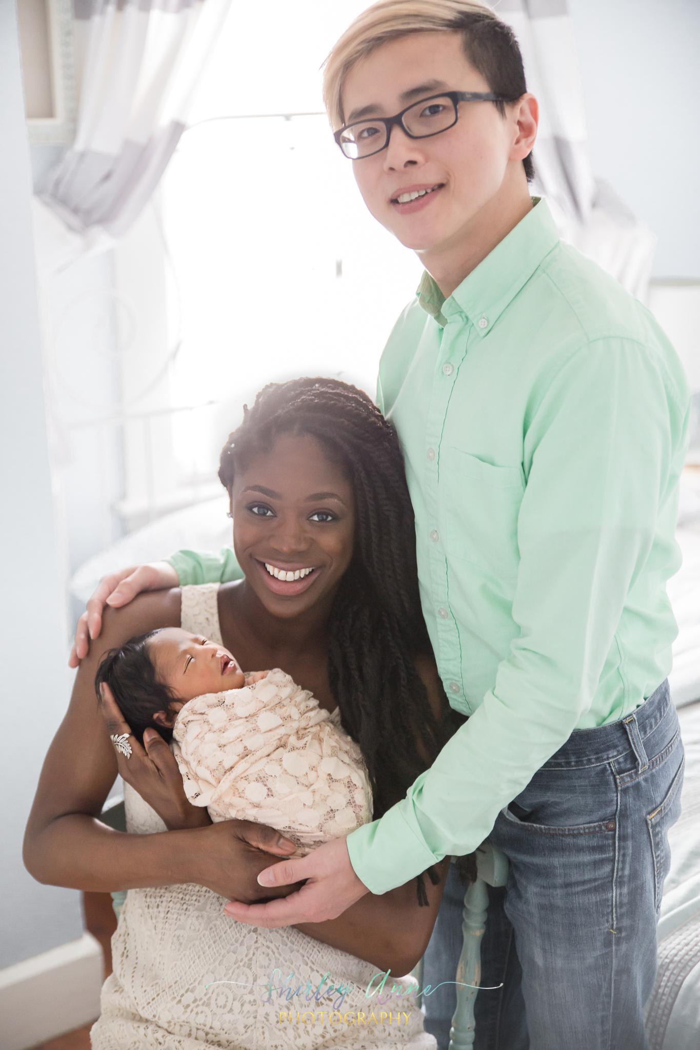 bi racial couple newborn session