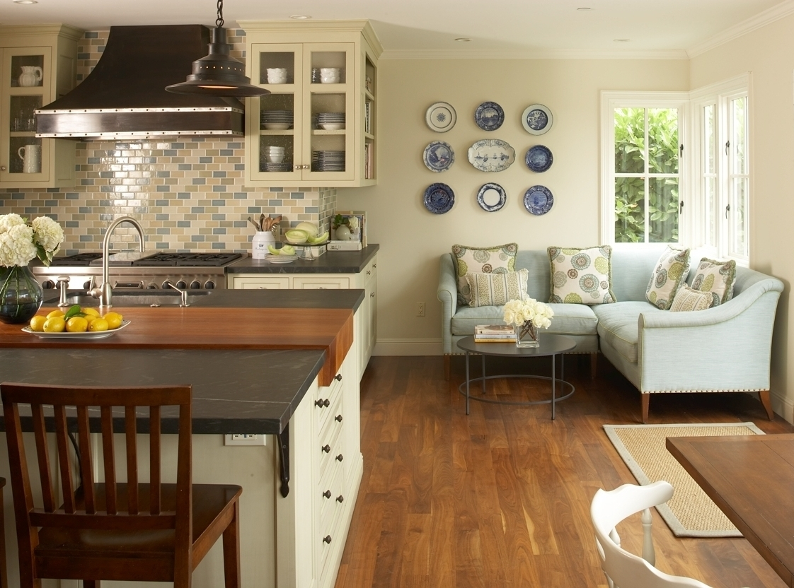 This corner sofa allows for good flow around the kitchen island.  See other airy kitchens here.