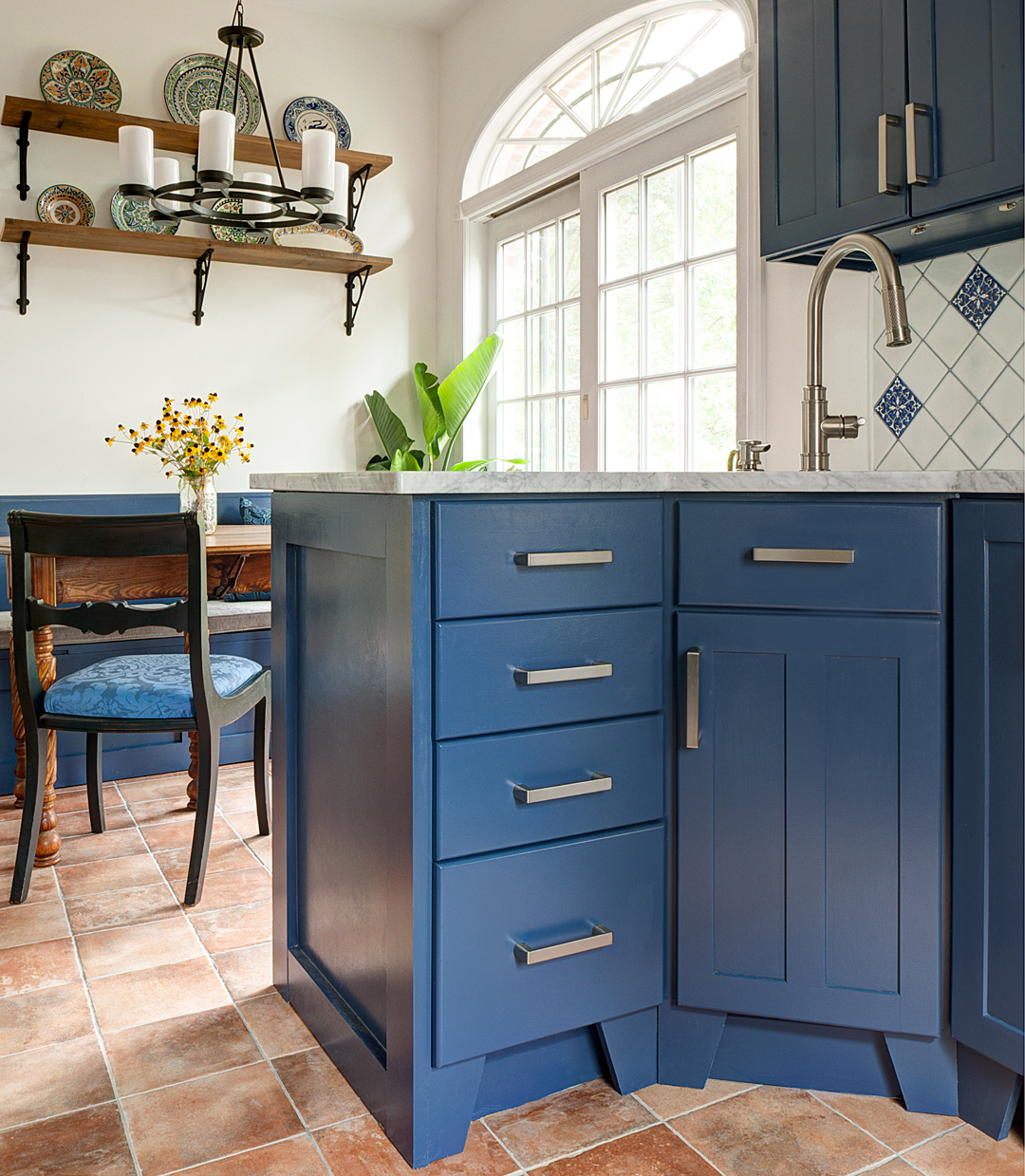 Large cabinet pulls are easy to grip. See more of this  kitchen here .