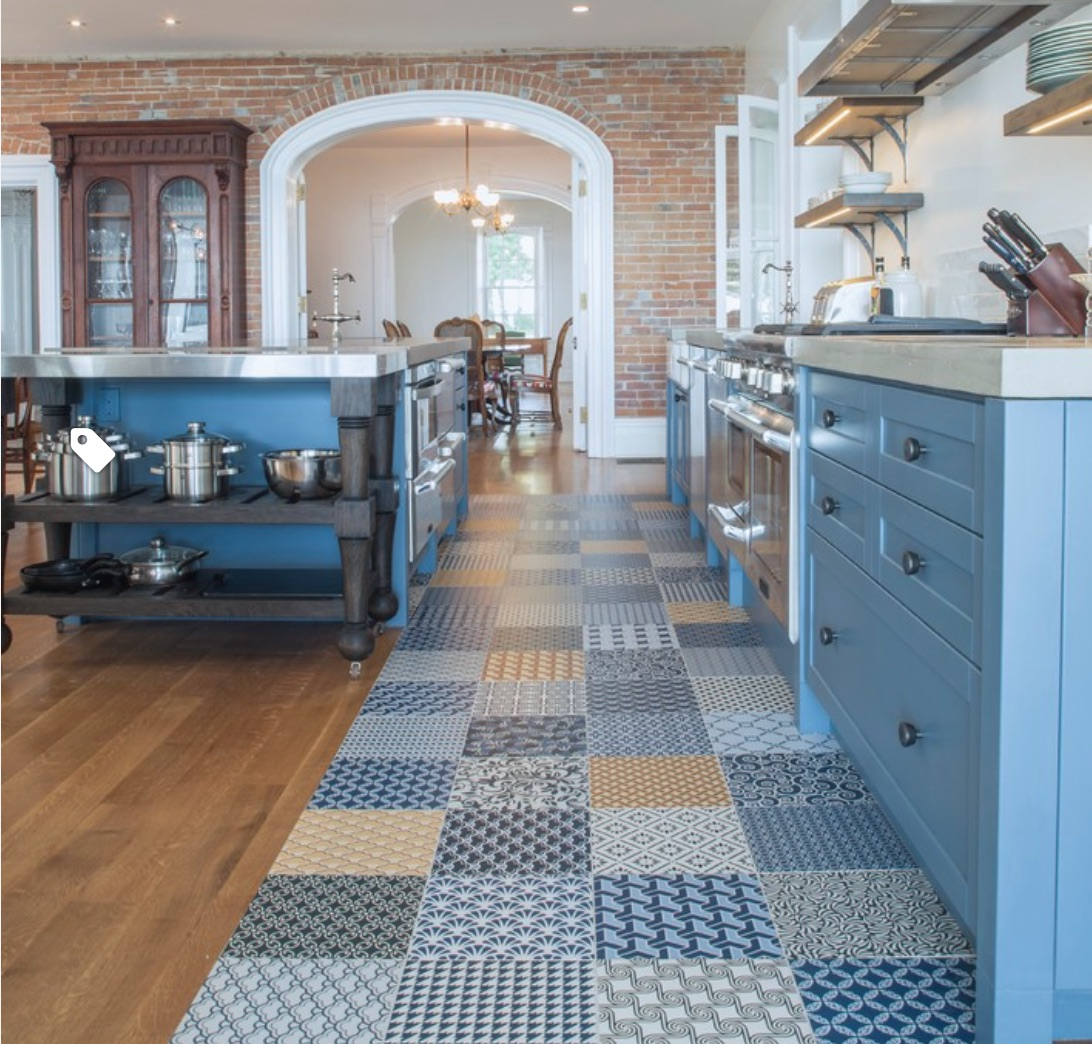 This cement tile floor by  Stacklab  is fun and durable.