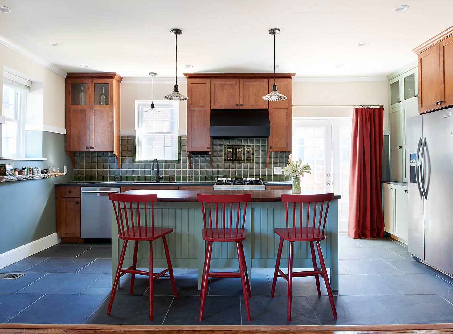 Decorative pendants provide task lighting over the sink and island.