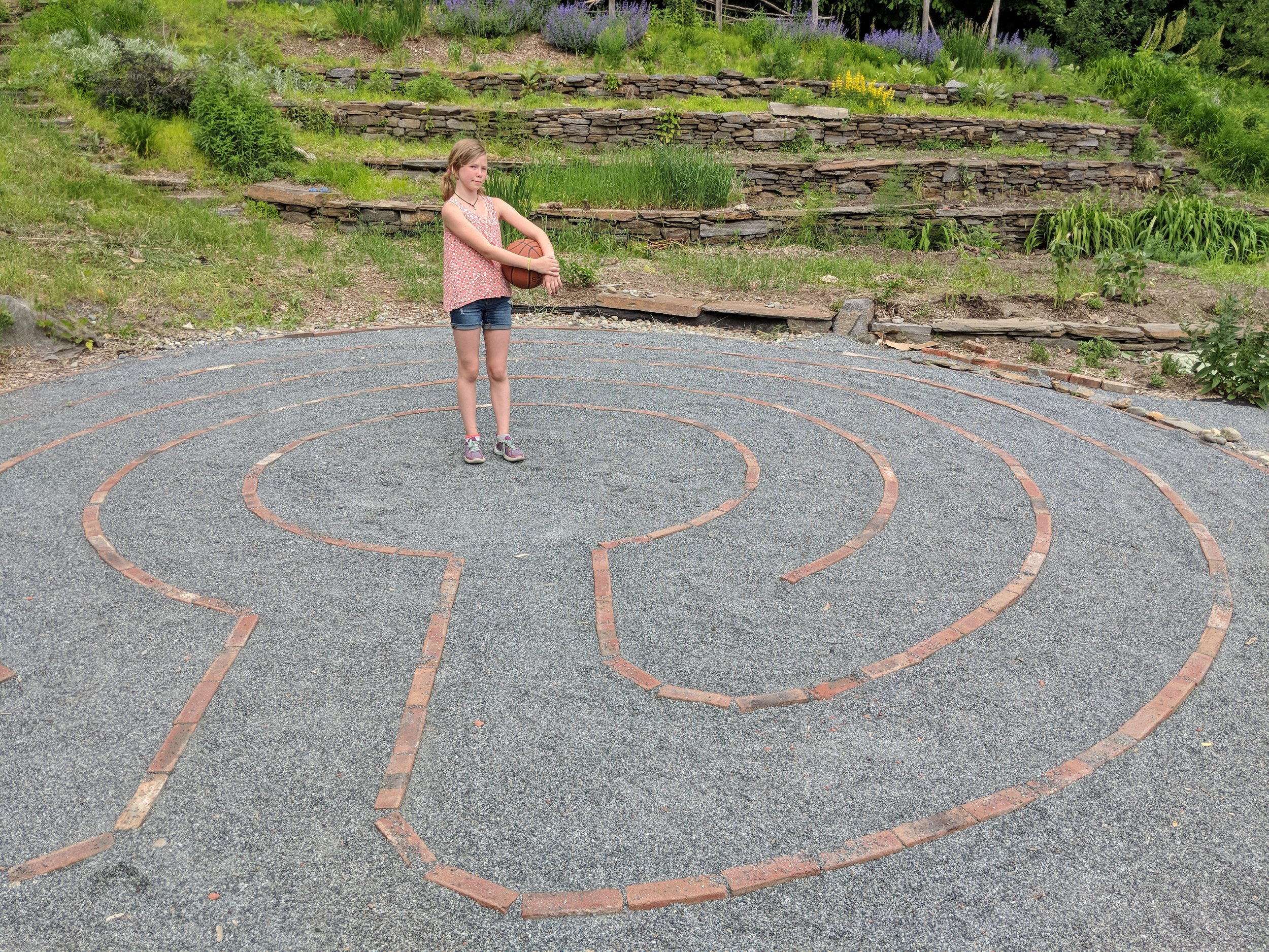 Una on the labyrinth at the White River Elementary school which she helped her mom build.