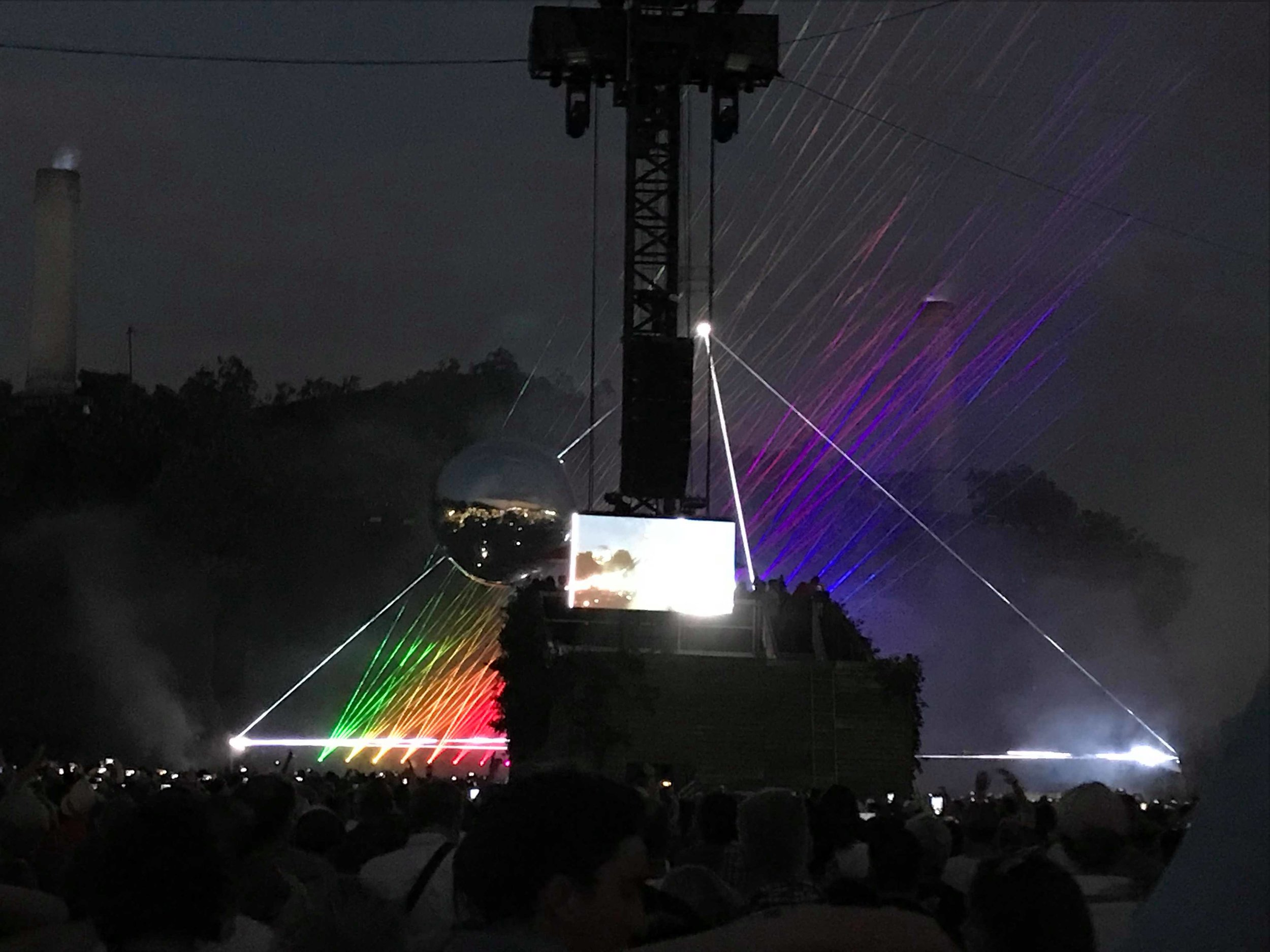 Dark Side of the Moon prism shining over the audience at Hyde Park
