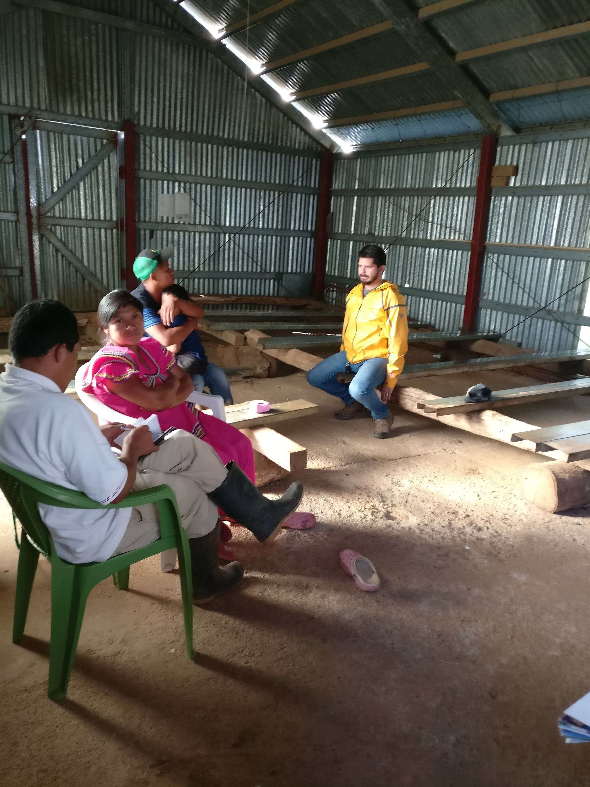 Meeting with Bernabe (green cap)