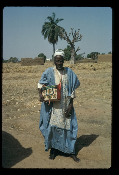 Alhaji Balarabe of Zaria City, addressed there as  Sarkin Dukawa  (Chief of the Leatherworkers), with one of his products: a satchel containing a copy of the Koran. A comprehensive collection of his leatherwork is in the British Museum.