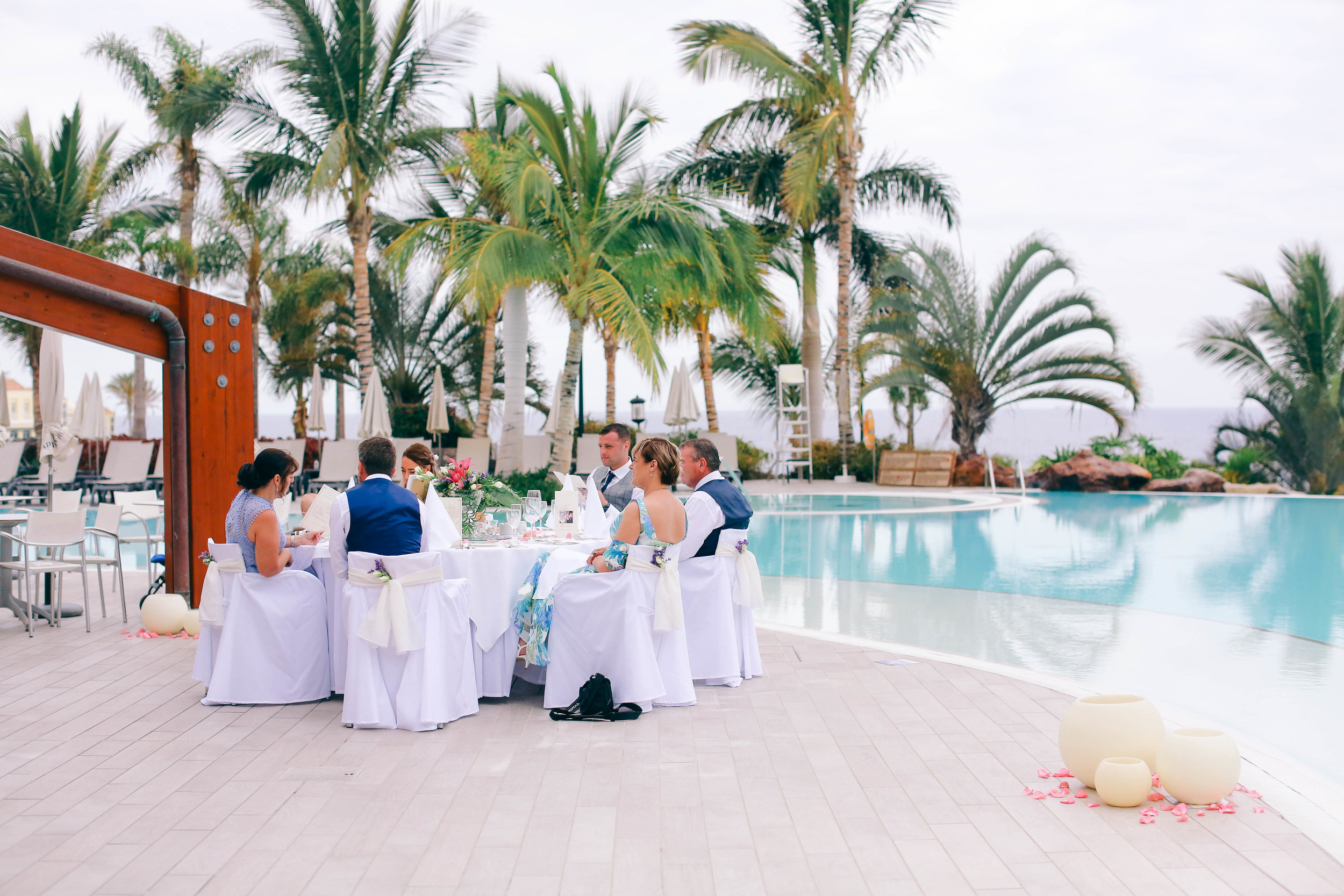 Small wedding dinner set up by the pools