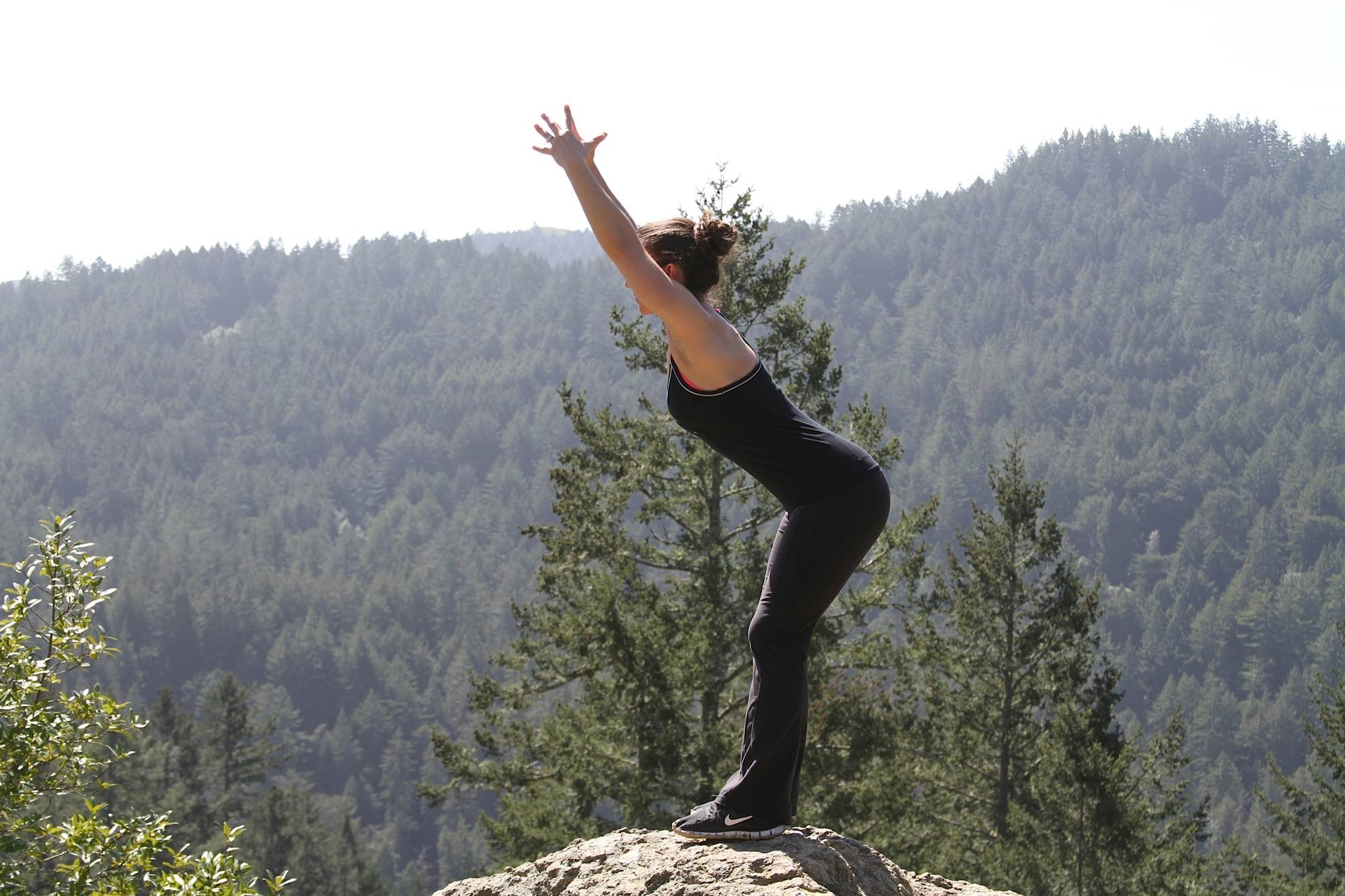 Carrie does a Foundation Training movement in the great outdoors. (Photo Courtesy Carrie Russell)