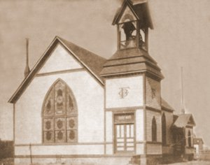 Baptist Church. In 1902, this Baptist Church was built on the corner of Chestnut and first where the Shamrock Station now stands. It served until 1940. A.W. Thompson in memory of his wife and child gave the bell pictured in the belfry. It is now in front of the Albert W. Thompson Memorial Library.