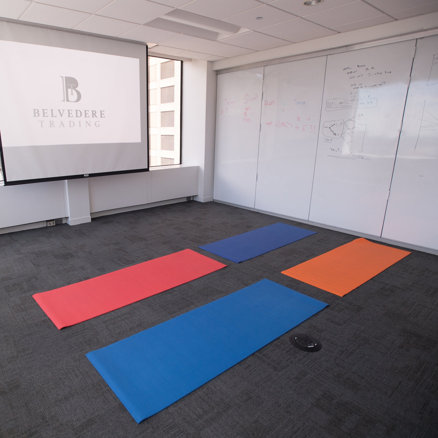 Yoga mats in a conference room.