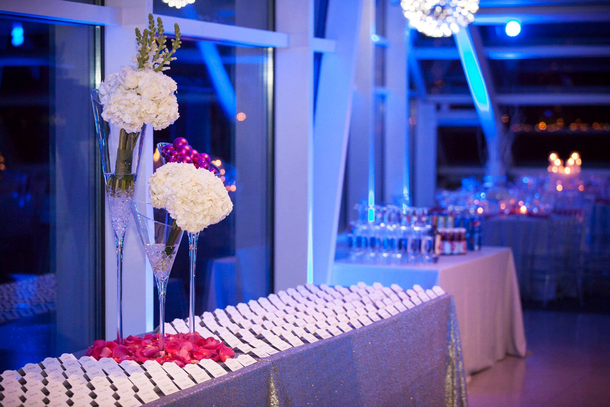 Holiday party. Table with name cards and a flower display.