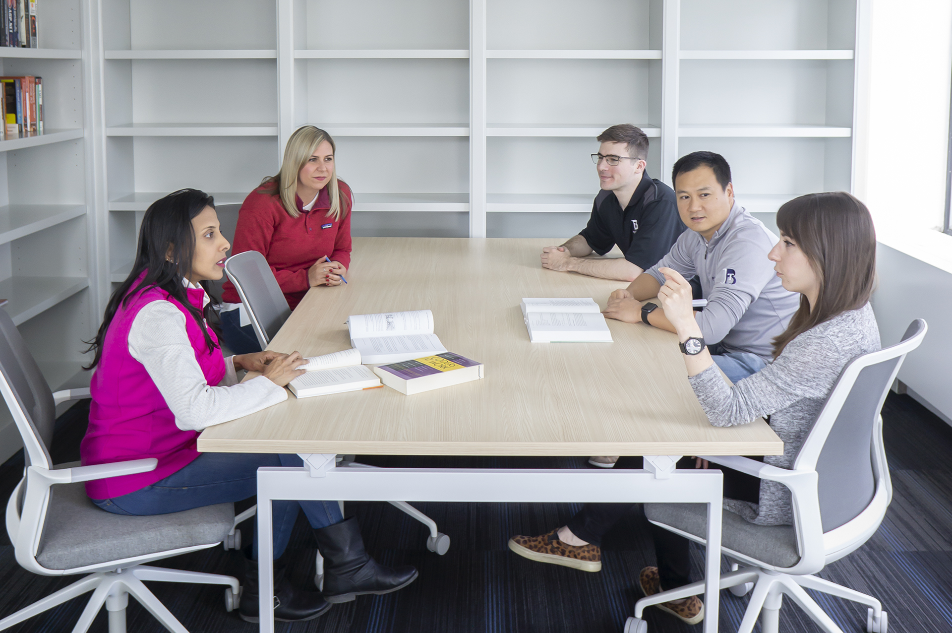 People in an office having a meeting.