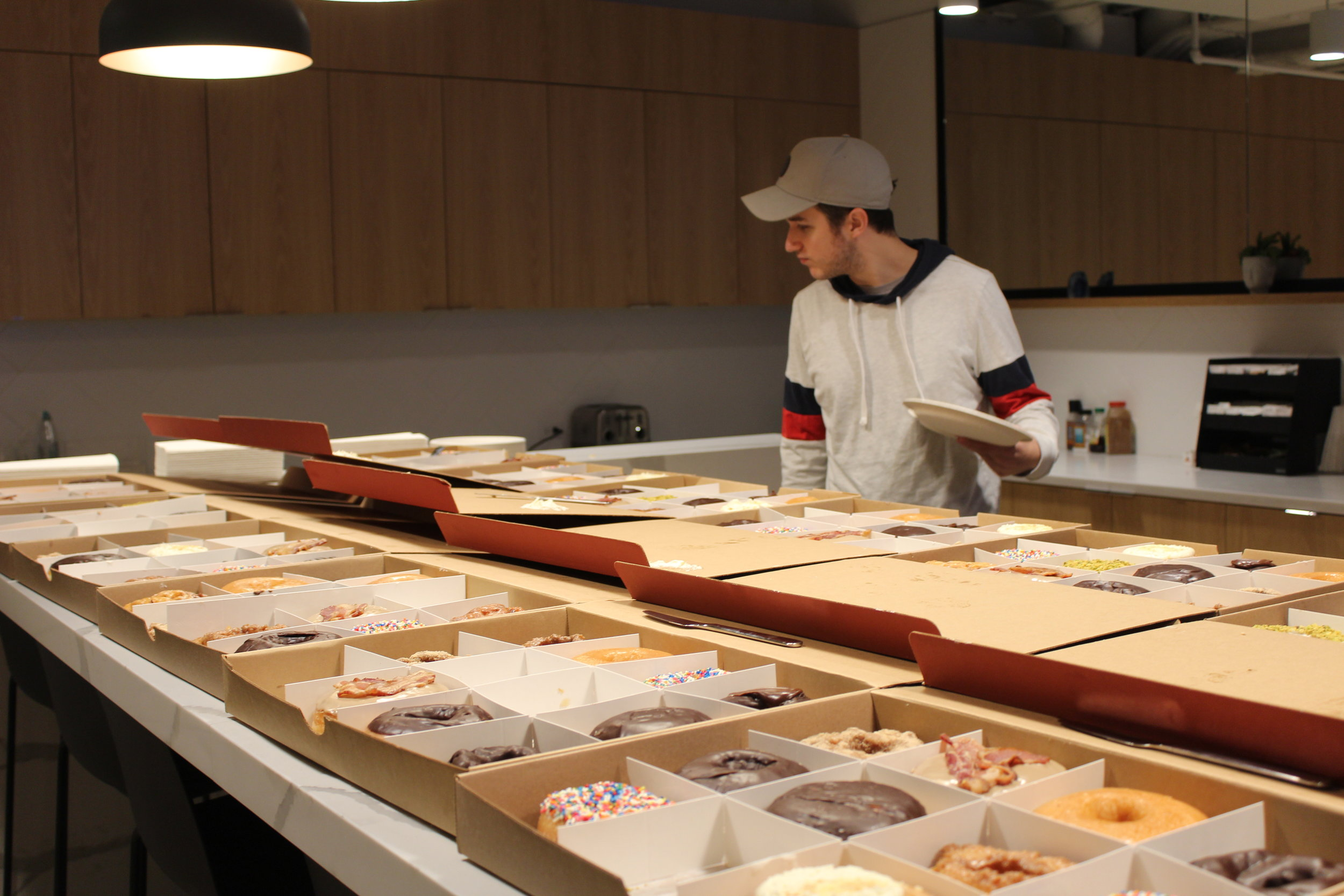 One employee overlooks dozens of donuts set out for National Donut Day
