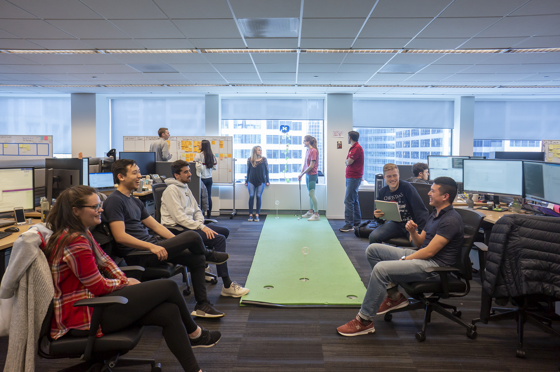 Photo of a team having a meeting in an open office environment
