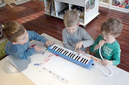 Learning to play the melodica with colour bars children created to devise musical compositions
