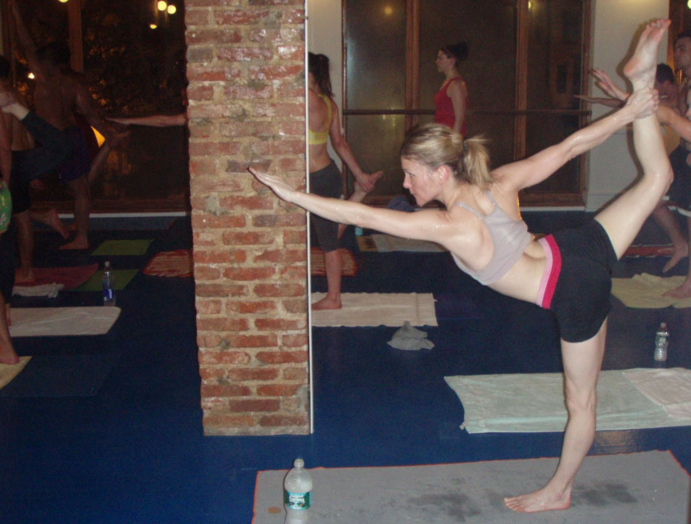Camille in standing bow pose