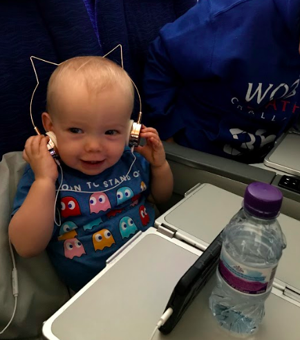 Scarlett enjoying a show on her mom's iPhone! :) Note: The headphones shown here are  NOT  recommended! They're cute but so impractical!! They were purchased before Aunty Lisa's smart recommendation in tip #3 above!