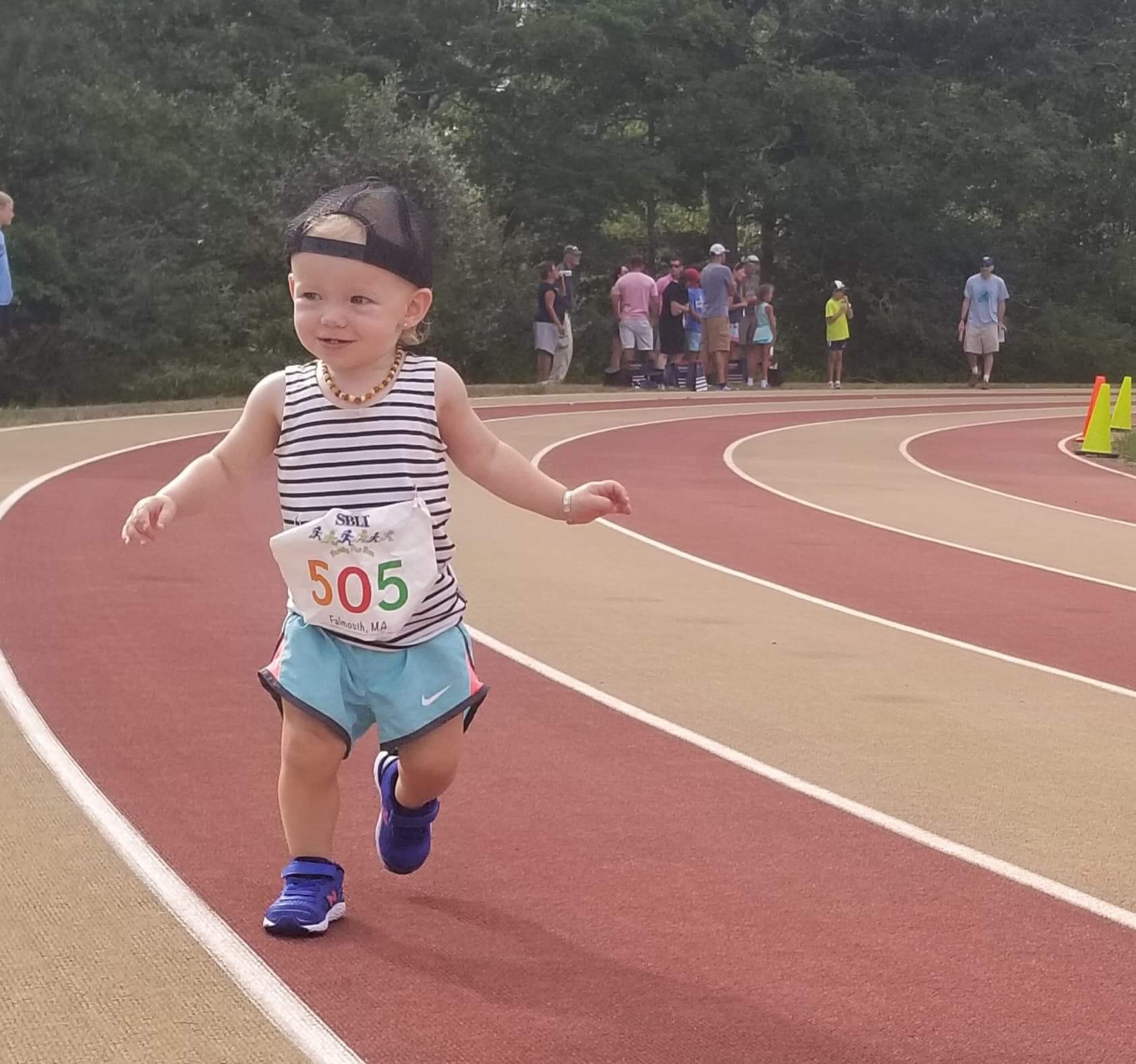 Here's Scarlett, FIT Founder Kelly McLay's daughter, on the track and keeping her paces in check. 😉