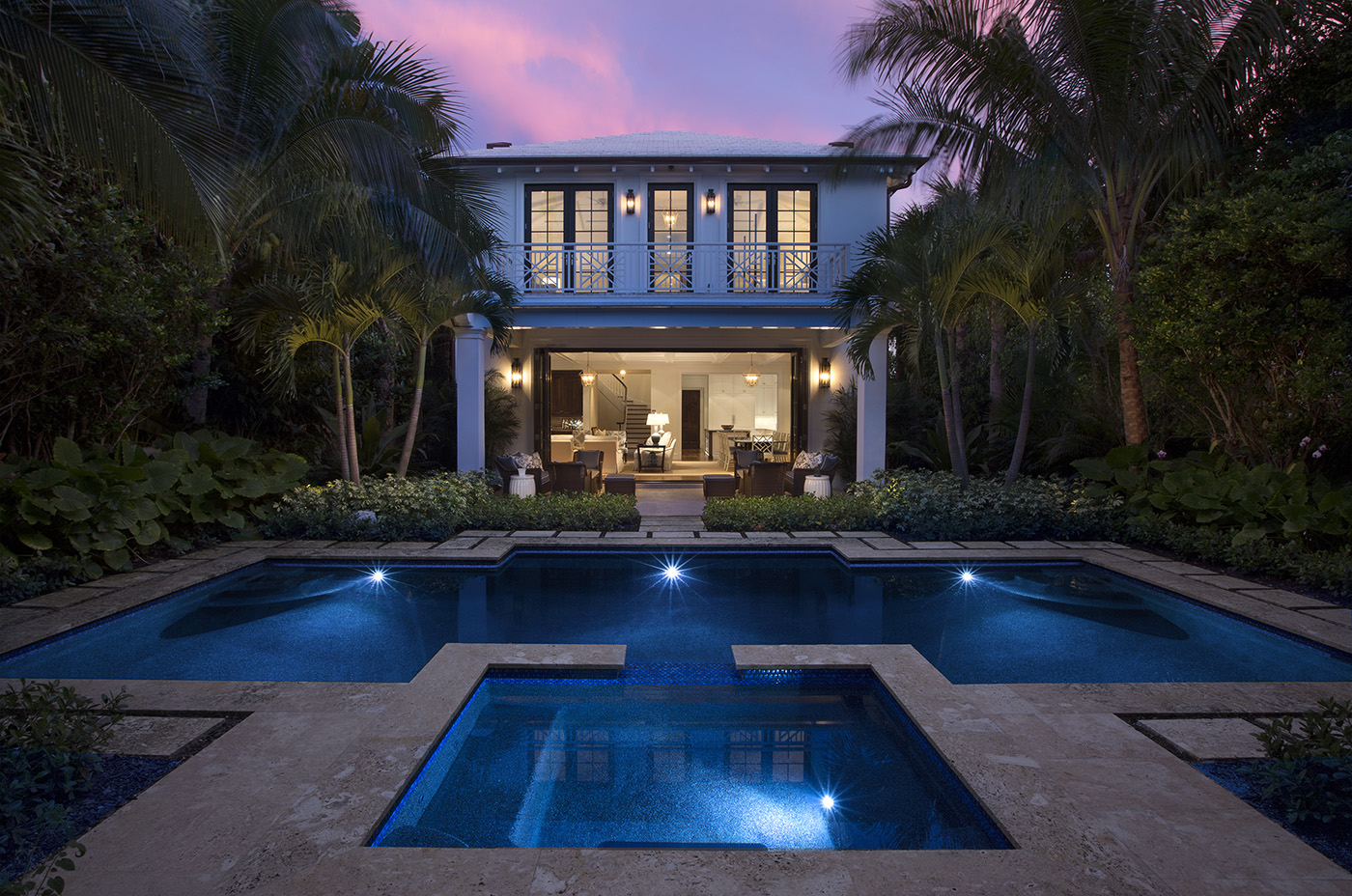 Beautiful pool and accompanying guest house on Brazilian Avenue, a project completed by Frisbie Group