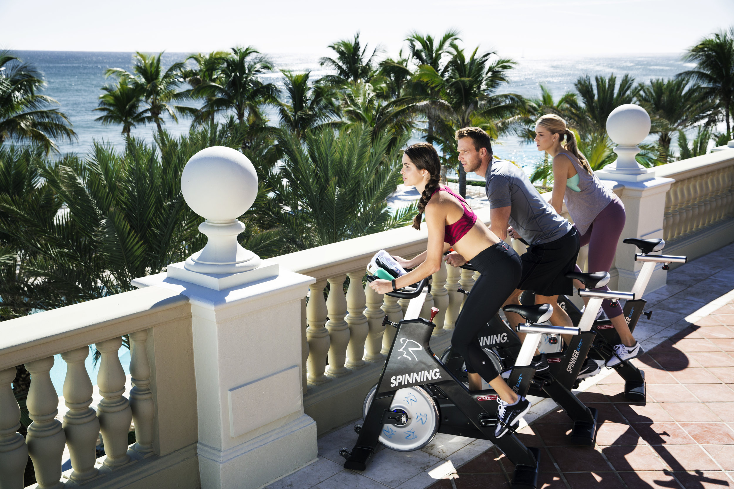 Cycling bikes on The Breakers' outdoor Ocean Fitness center terrace, which overlooks the ocean