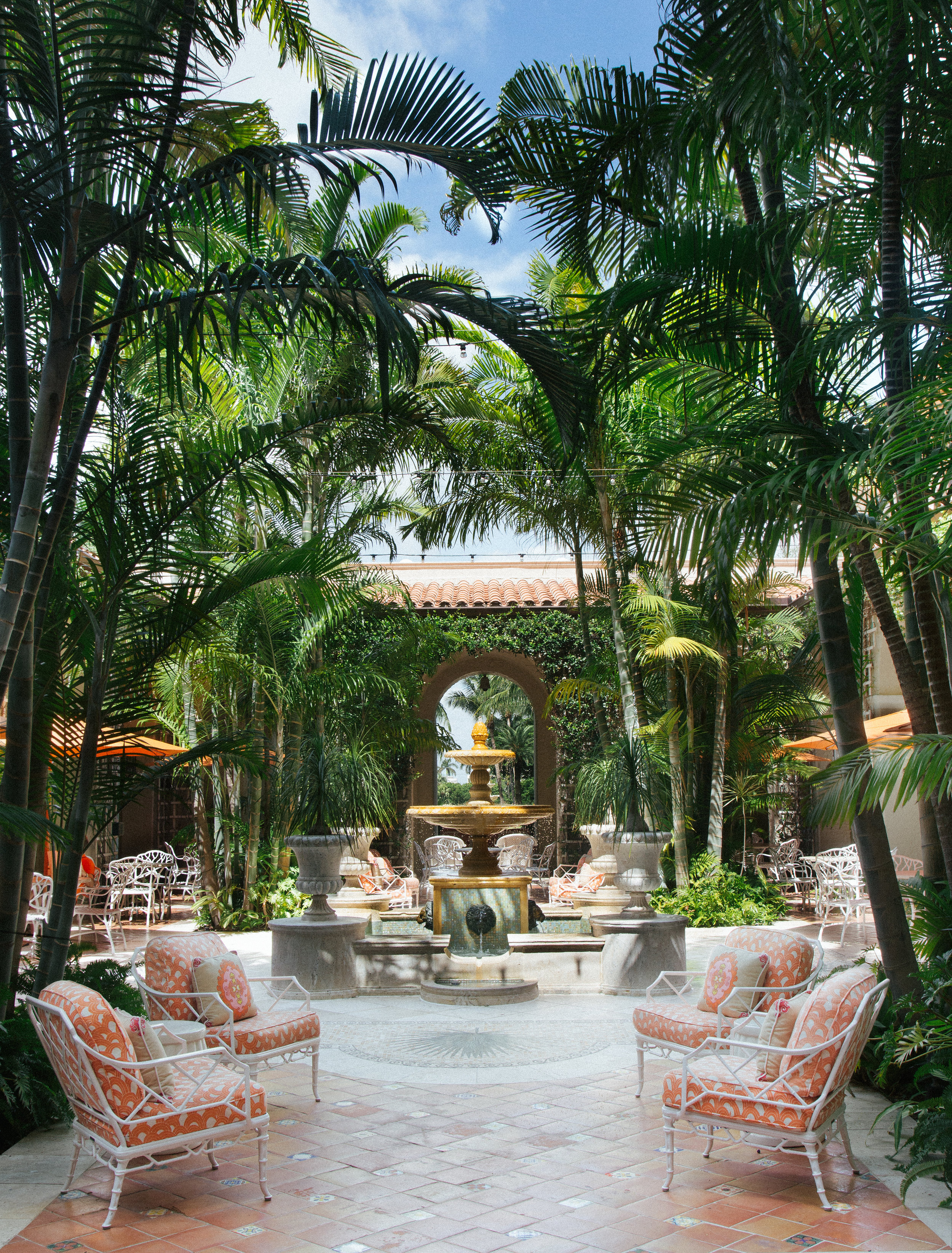 The picturesque Palm Courtyard surrounds The Breakers' shops, offering guests a cozy spot to relax