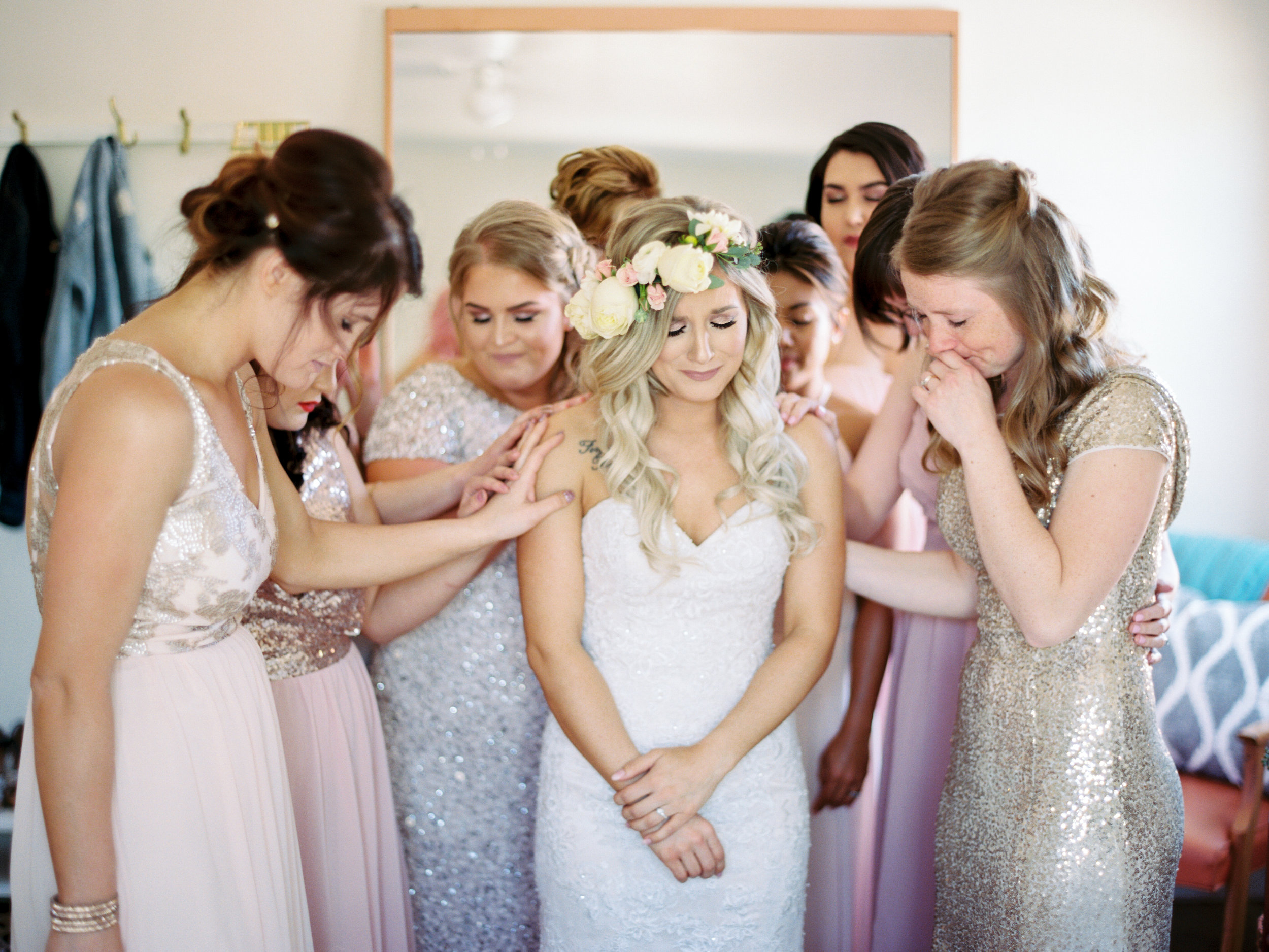 A beautiful moment of prayer with my sisters, mom and bridesmaids